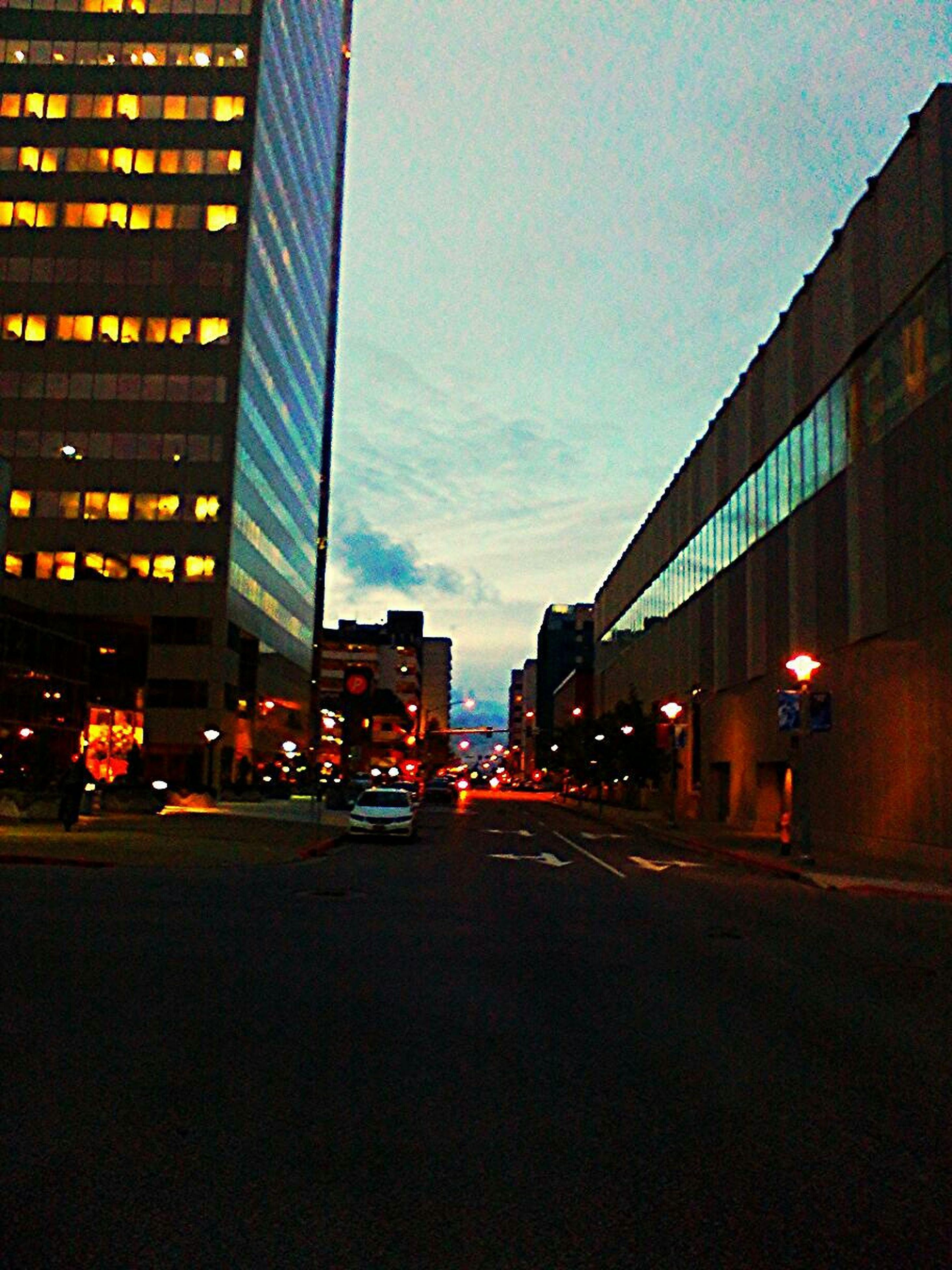 building exterior, architecture, illuminated, built structure, city, transportation, night, street, car, land vehicle, city street, city life, road, building, mode of transport, street light, traffic, sky, dusk, outdoors