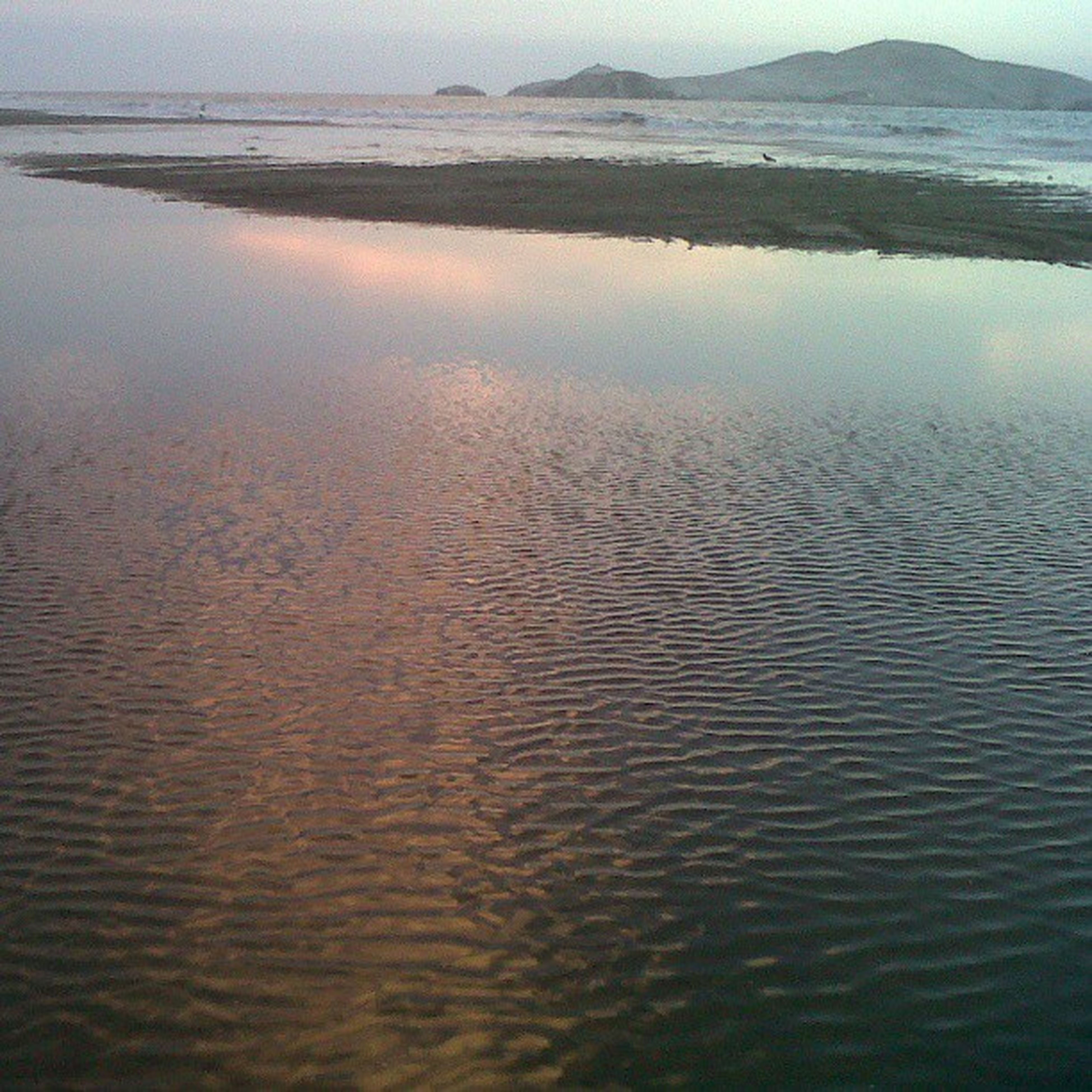 water, sea, tranquility, tranquil scene, beach, scenics, beauty in nature, rippled, nature, shore, sand, reflection, waterfront, idyllic, horizon over water, coastline, calm, high angle view, wave, seascape
