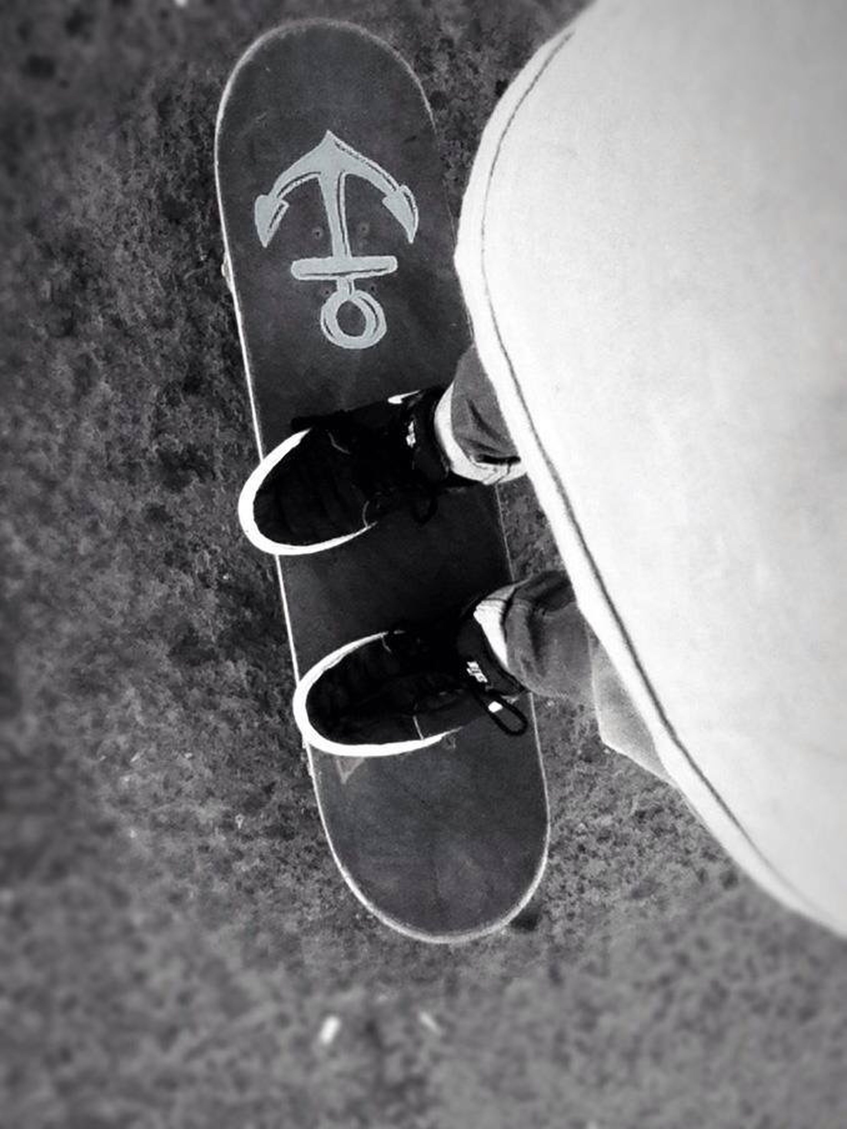 shoe, footwear, high angle view, low section, person, close-up, street, pair, shadow, canvas shoe, still life, metal, day, single object, men, selective focus, skateboard