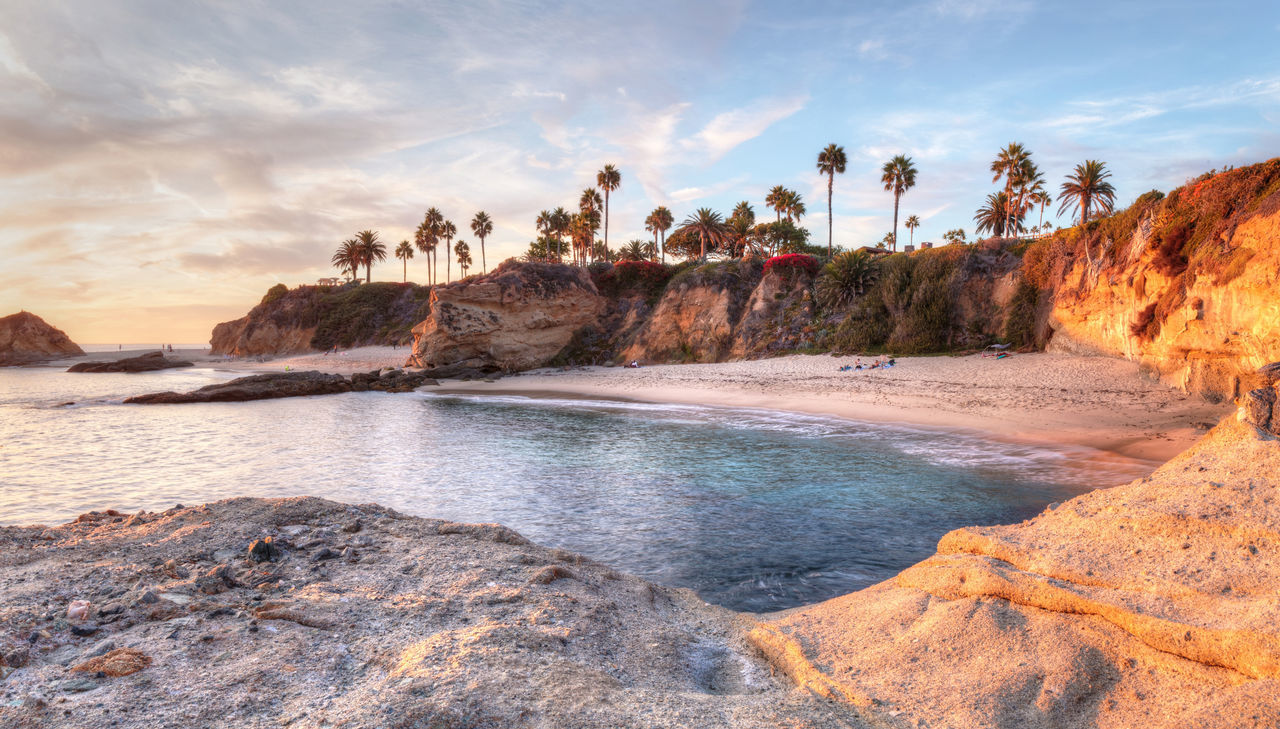 Sunset view of Treasure Island Beach at the Montage in Laguna Beach, California, United States Beach California Cliffs Coastline Coastline Landscape Laguna Beach Laguna Beach, CA Ocean Panorama Sand Sea Sky And Clouds Sunset Sunsets Treasure Island Waves