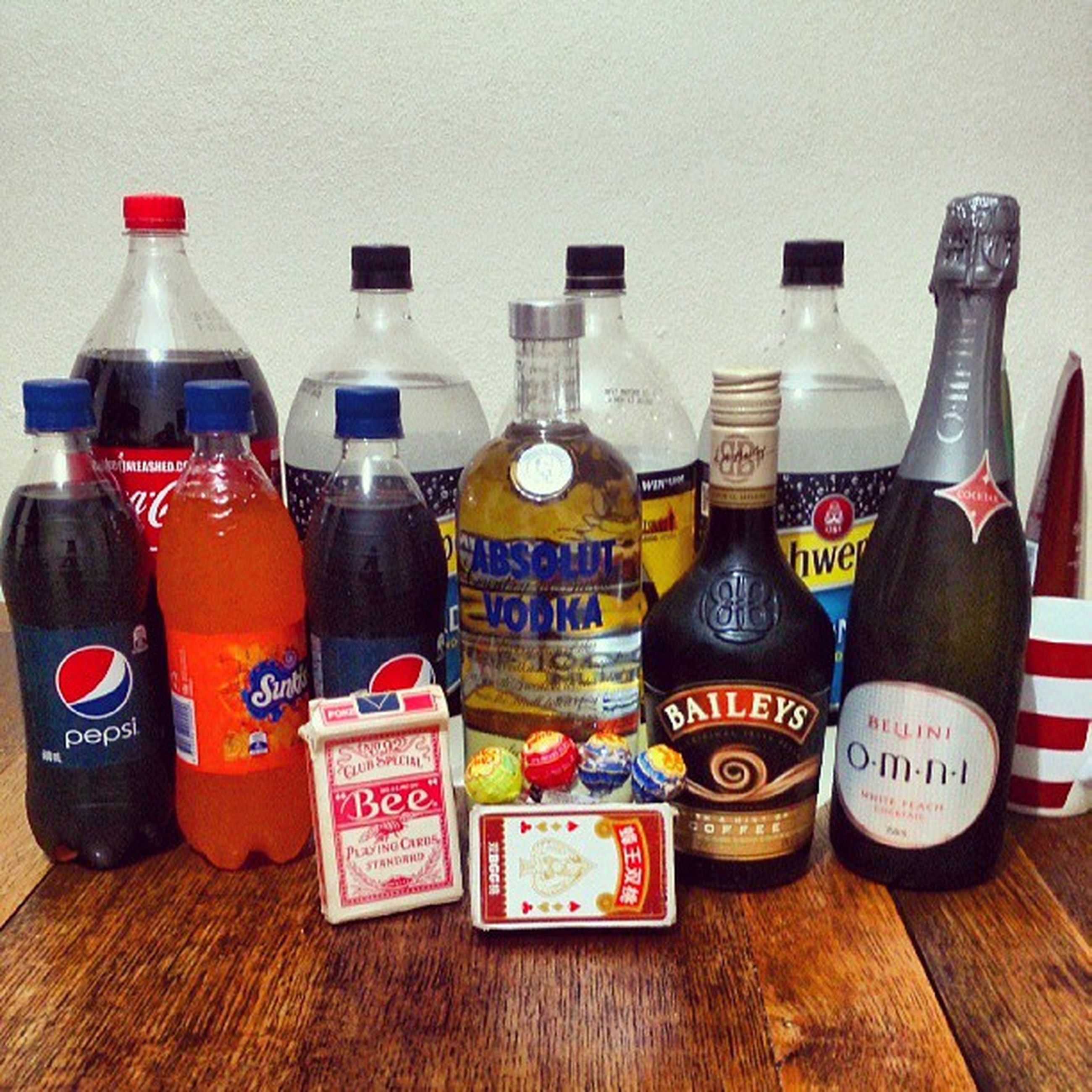 indoors, still life, variation, table, food and drink, choice, large group of objects, arrangement, bottle, wood - material, multi colored, order, side by side, abundance, close-up, collection, freshness, drink, no people, group of objects