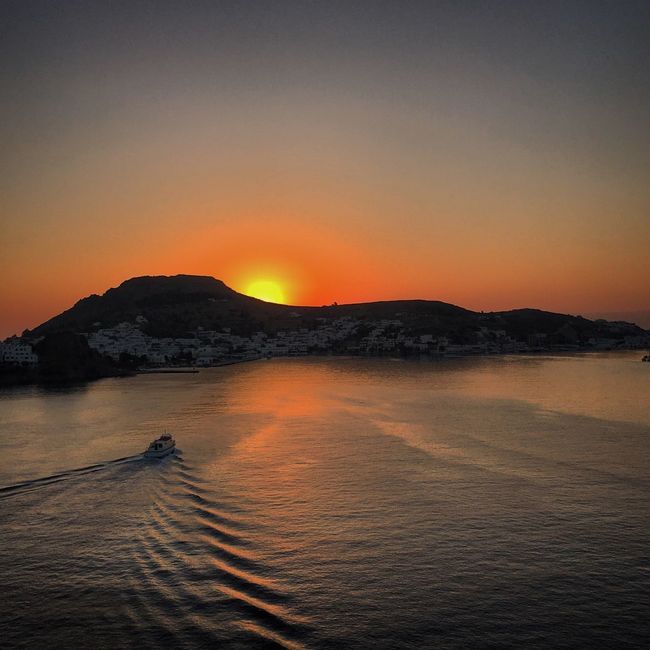 Sunset Water Scenics Tranquil Scene Beauty In Nature Sea Tranquility Mountain Sun Orange Color Idyllic Waterfront Nature Clear Sky Rippled Vibrant Color Non-urban Scene Majestic Mountain Range Vacations