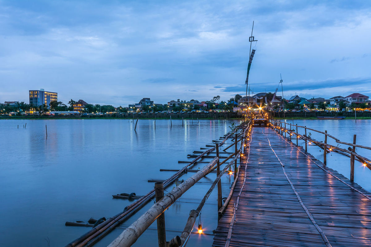 PHAYAO, THAILAND - JULY 19, 2016: The bamboo bridge, The bamboo bridge of Wat Ti Lok Aram temple in kwan phayao off freshwater lake of Thailand. Day is the important Buddhist. ASIA Bamboo Bridge Boat Buddhist City Cloud Cloud - Sky Cloudy Diminishing Perspective Harbor Illuminated Important Jetty Kwan Phayao Mode Of Transport Nature No People Outdoors Pier Sky Temple Thailand The Way Forward Wat Ti Lok Aram Water
