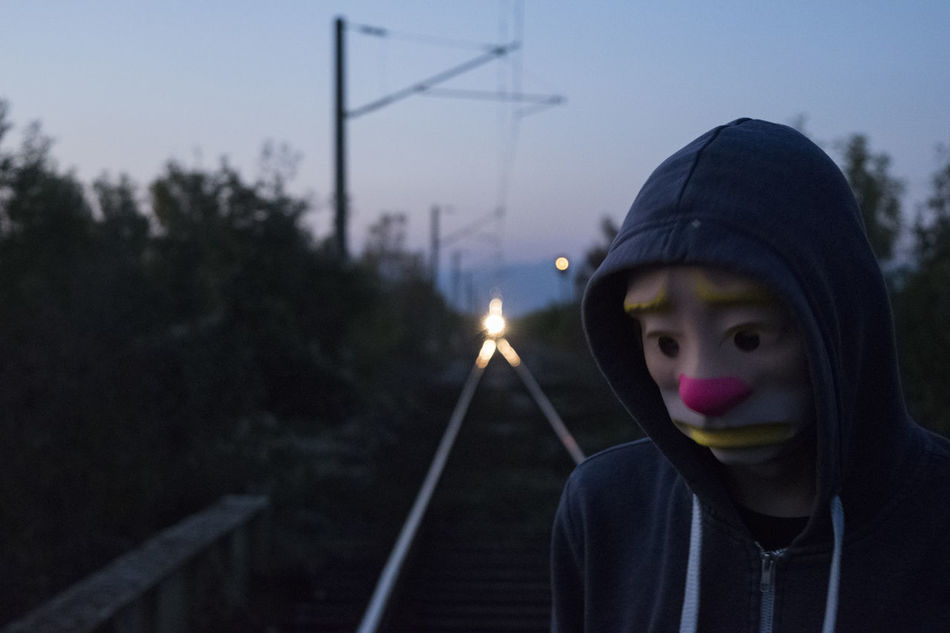 The best moment in all my photos for 2015. My friend in front of coming train. Alone Capture The Moment Clown Crazy Clown Mask Darkness Evening Mask My Best Photo 2015 Night One Person Person Rails Sad Sad Face Sadness Suicide Train Eyeemphoto