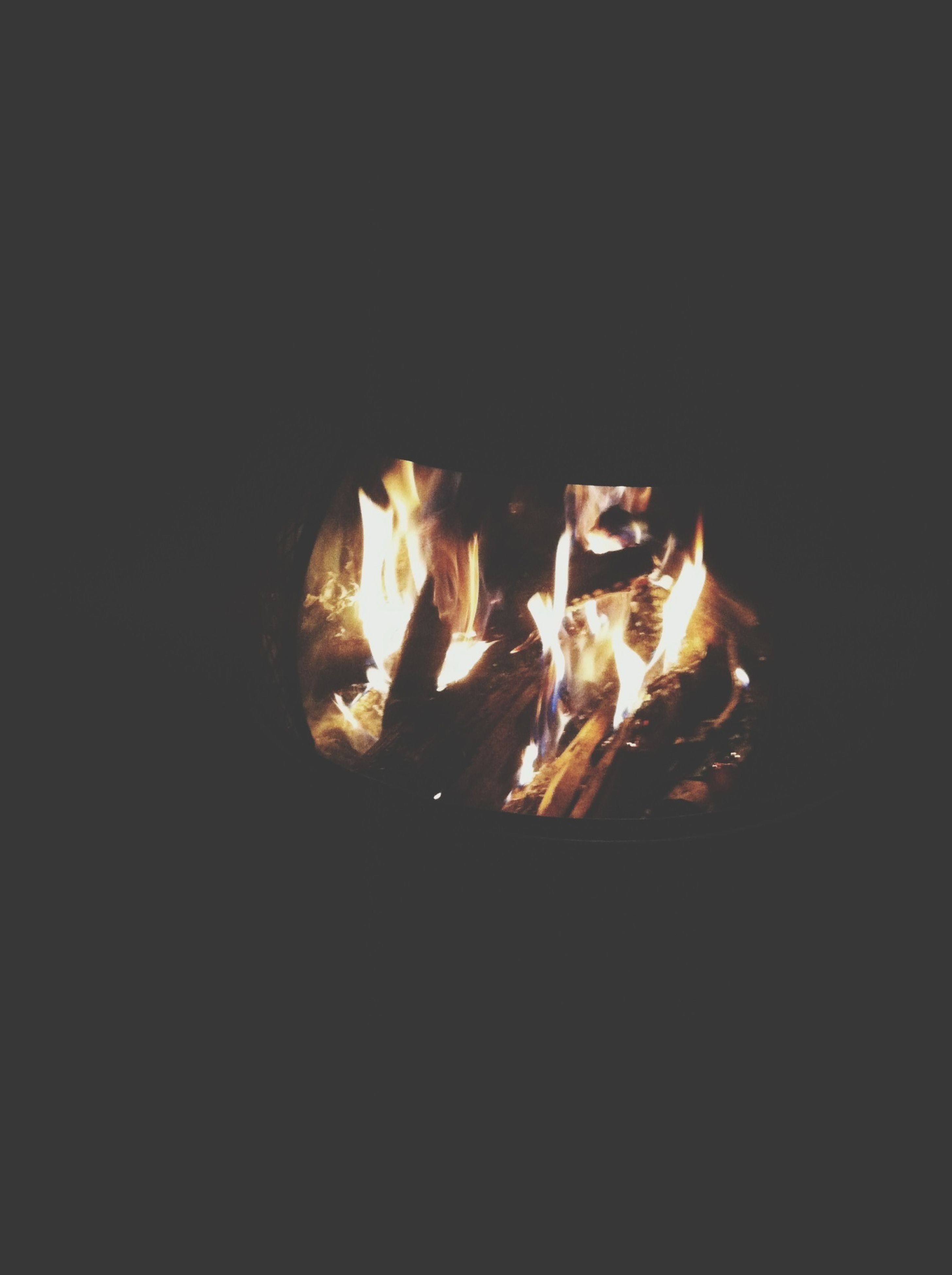 flame, burning, heat - temperature, fire - natural phenomenon, glowing, night, bonfire, firewood, fire, dark, heat, close-up, campfire, orange color, copy space, illuminated, no people, wood - material, light - natural phenomenon, motion