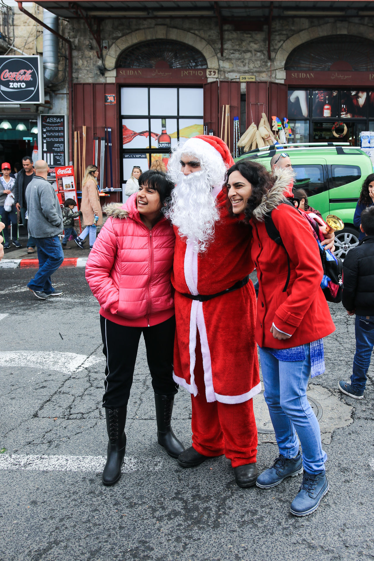Haifa, Israel - December 17, 2016 : Santa Claus posing for photographers in the German Colony in Haifa, Israel Adult Camera Celebration Christmas City City Claus Colony Day December German Haifa Happy Holiday Israel Outdoors People Photographers Picture Posing Santa Seasonal Standing Street