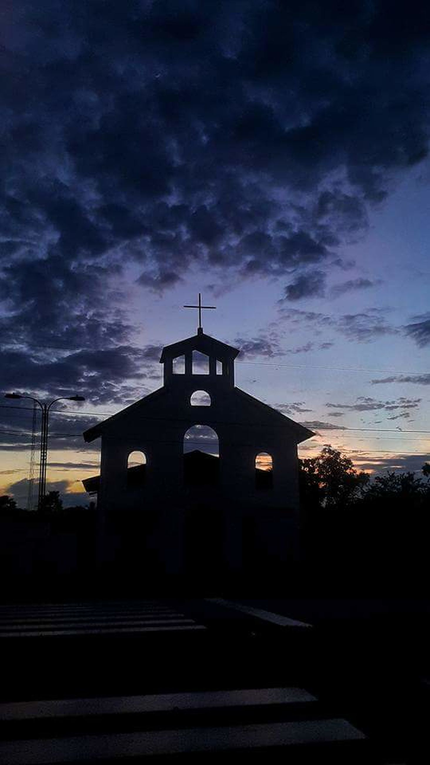 architecture, built structure, building exterior, silhouette, sky, cloud - sky, dark, outdoors, cloudy, facade, cloud, place of worship, no people