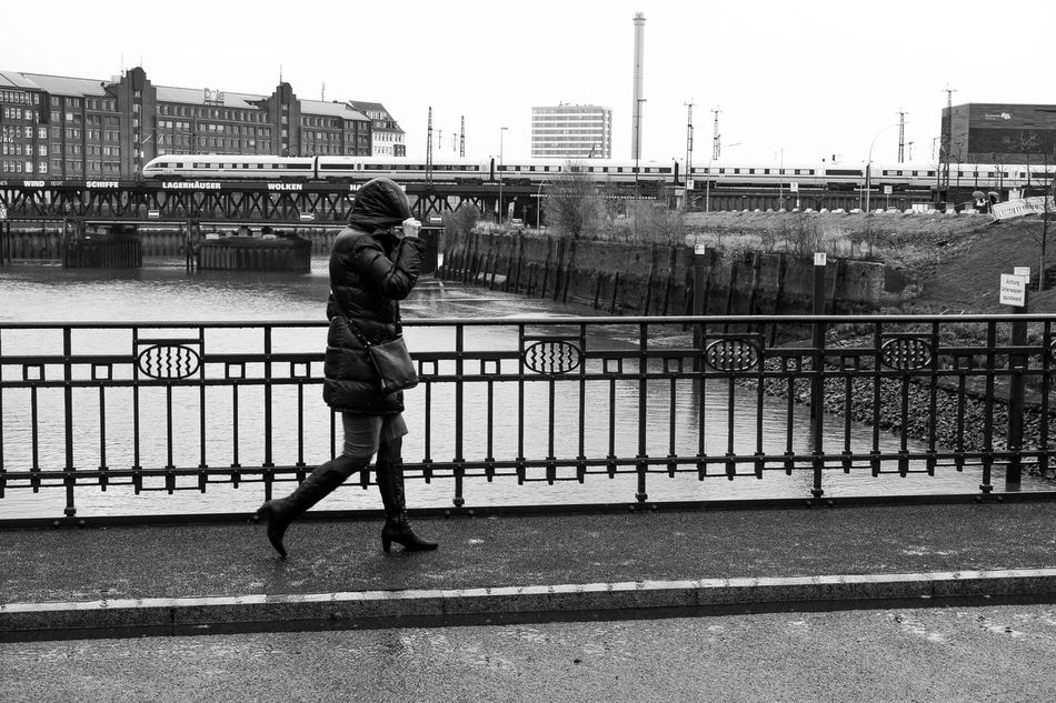 hanseatic easteregg : Where is the sun today !? Black And White Black And White Photography Blackandwhite EyeEm Best Shots Female Friend Hamburg Hamburg Harbour Hamburgmeineperle Monochrome Nikonphotographer Nikonphotography One Person Open Edit People People Photography Protection Railing Running Schwarzweiß Sidewalk Sidewalk Photograhy Weather Weather Photography Woman