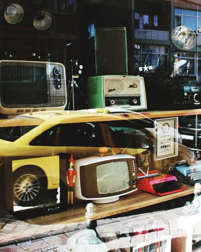 Antique Old Television Radio Telephone Typewriter Books Pinocchio Reflection Taxi Building Street Streetphotography Colors Istanbul Kadıköy Turkey