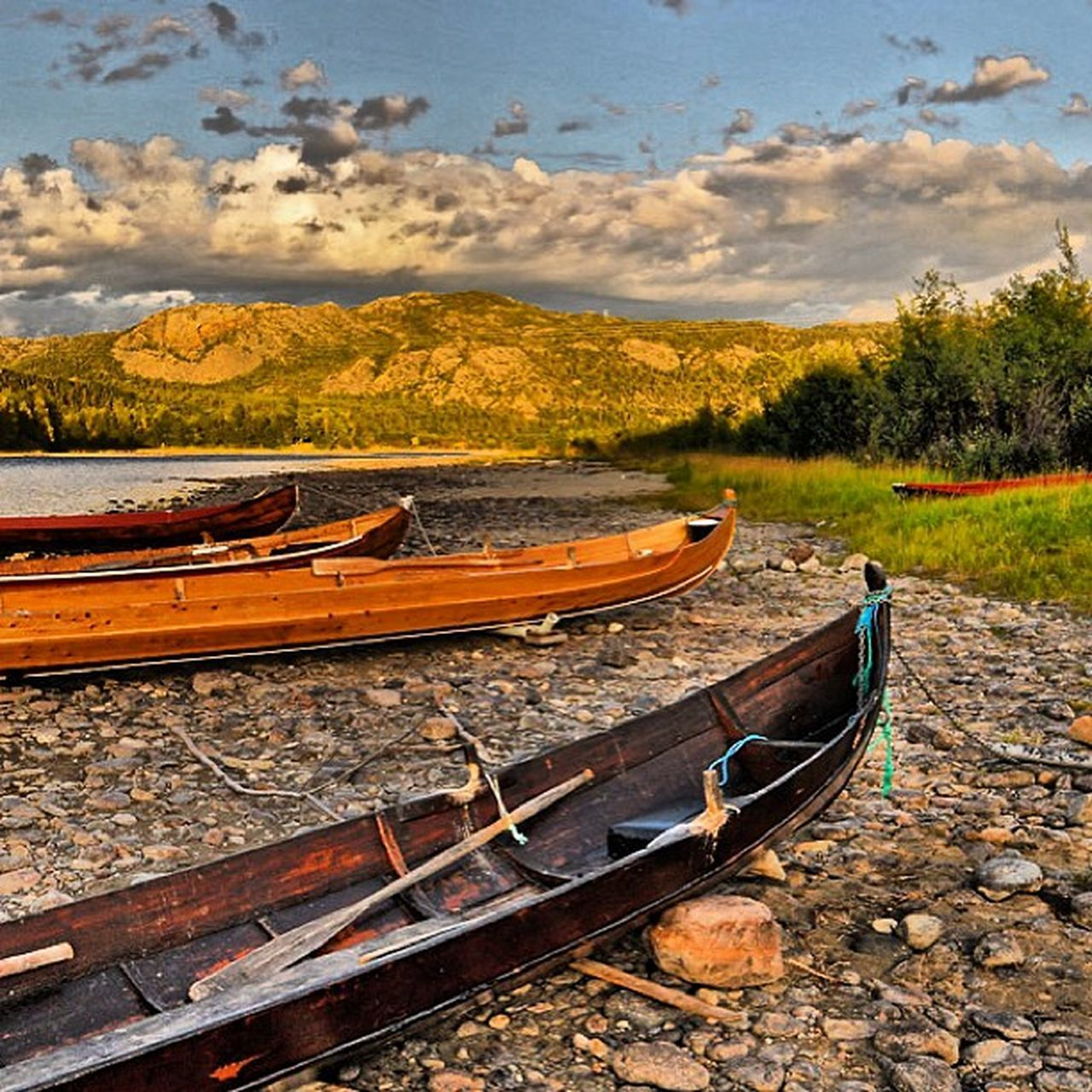 nautical vessel, moored, transportation, wood - material, mode of transport, cloud - sky, water, sky, nature, no people, beauty in nature, outdoors, scenics, canoe, beach, rowboat, day, sea, landscape, mountain, oar, kayak, tree, outrigger