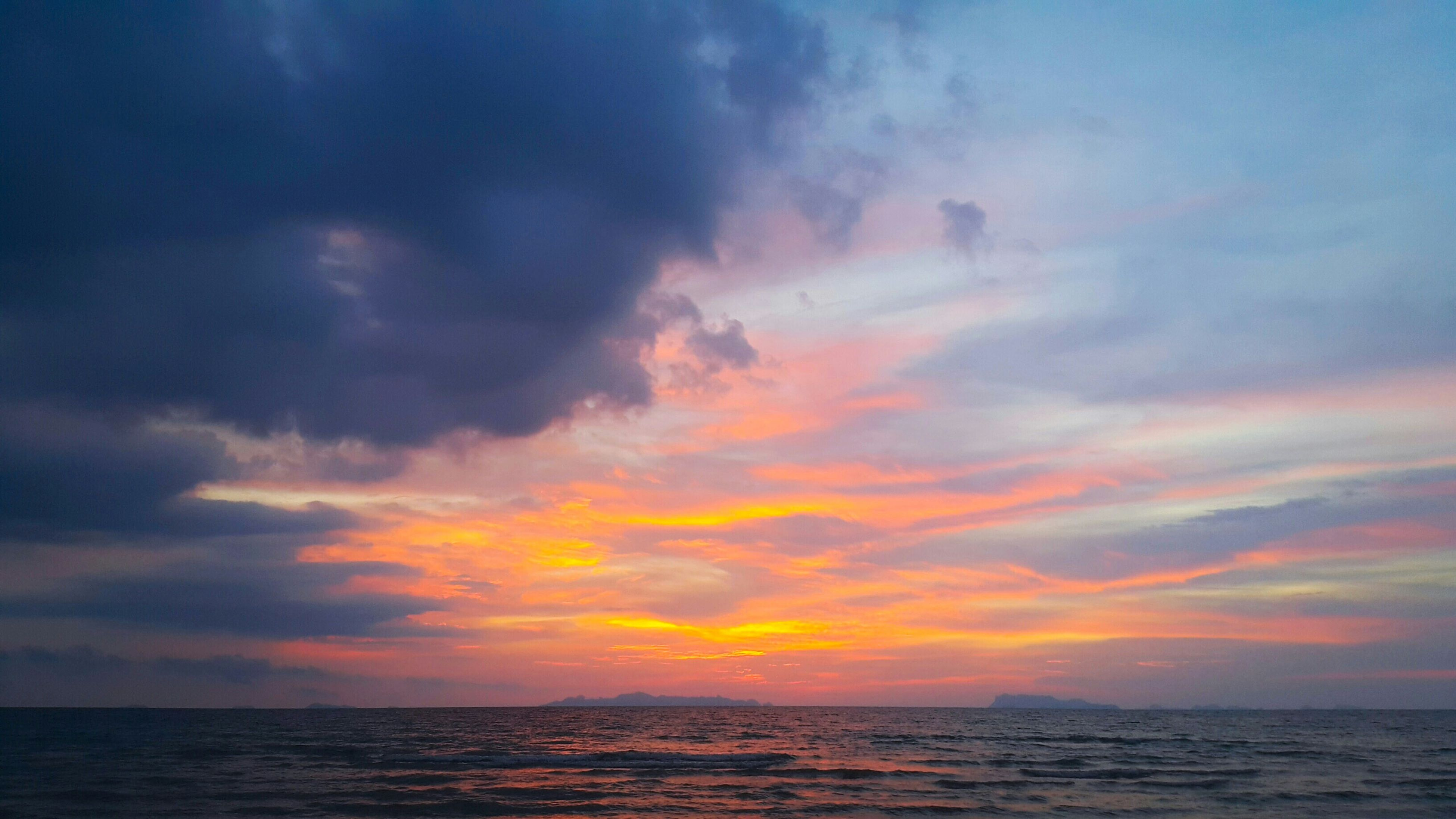 sea, horizon over water, scenics, sunset, tranquil scene, water, beauty in nature, sky, tranquility, waterfront, idyllic, nature, cloud - sky, orange color, cloud, cloudy, dramatic sky, outdoors, seascape, no people