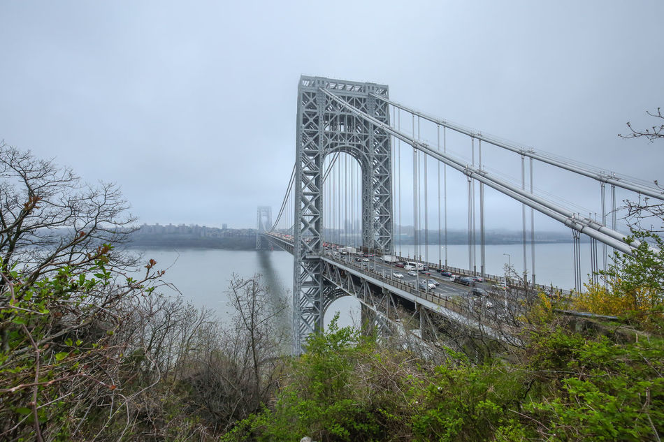 Architecture Bridge - Man Made Structure Built Structure Connection Day Engineering Fog George Washington Bridge Nature No People Outdoors River Sky Suspension Bridge Transportation Travel Destinations Water