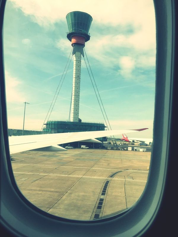 Airplane Airport Airplane Wing Airport Runway Air Vehicle Aircraft Wing Plane Runway Holiday England Photo Controltower Travel Sky Outdoors Journey No People Window Transportation Day Cloud - Sky