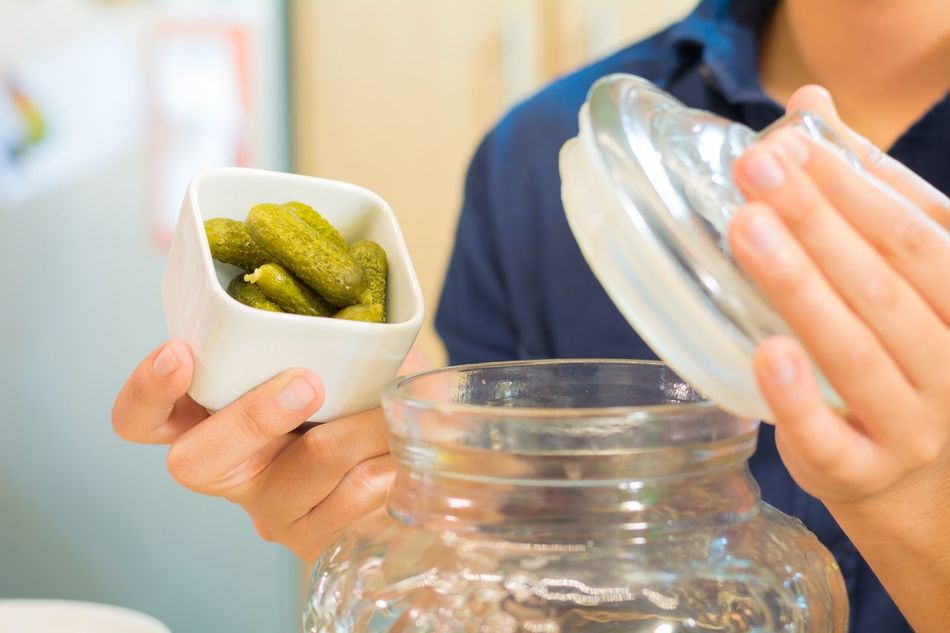 Pickles Pickles Human Hand One Person Food And Drink Kitchen Water Real People Human Body Part Holding Indoors  Food Focus On Foreground Lifestyles Freshness Close-up Day Ready-to-eat People