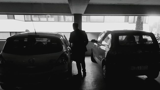 A Dear friend of Mine - his car Next to my car by accident. I decided to take a Photo of this and be suddenly walked into the picture and effected that to a great snapshot:) Cars Parking Lot Parking Garage Parking Deck Balingen Blackandwhite Light And Shadow Abstractart Abstract German Cars Darkness And Light Dark Black & White Blackandwhite Photography By Accident Alone Alone In The Dark Parked Cars Friendship Grotty Dimmed Parking Space Inspirational Inspirations Everywhere. Home Is Where The Art Is