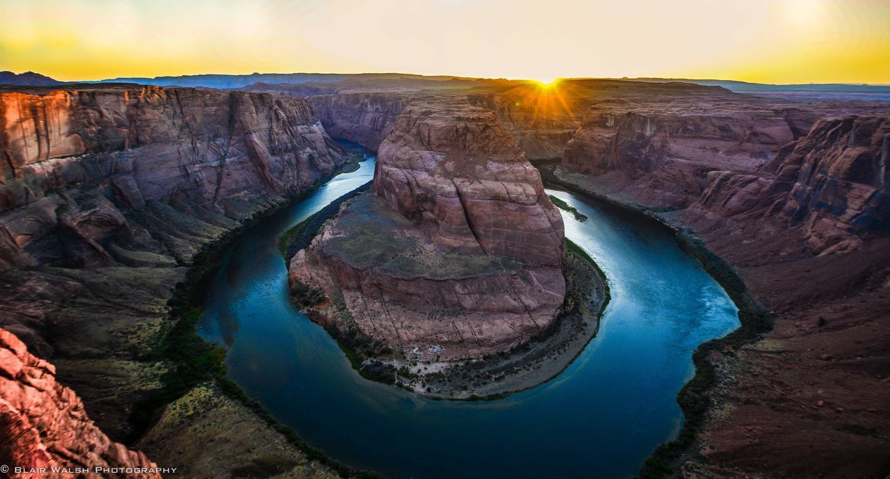 geology, scenics, beauty in nature, sunbeam, nature, sunlight, sun, physical geography, tranquility, river, rock - object, travel destinations, outdoors, waterfall, sunset, tranquil scene, no people, tourism, travel, landscape, sky, water, power in nature, day
