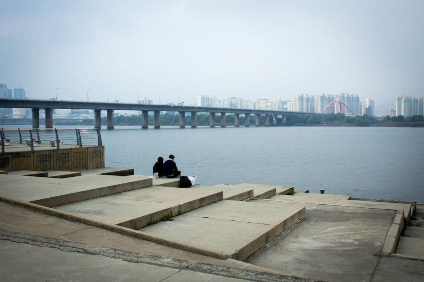 Walking the Yeouido Hangang Park sharing a typical afternoon with the locals and enjoying the river view. Architecture ASIA Auditorium City Cityscape Day Han River Han River Park Outdoors Park River Riverside Seoul Sky South Korea Stairs Street Street Photography Travel Photography View Water Yeouido