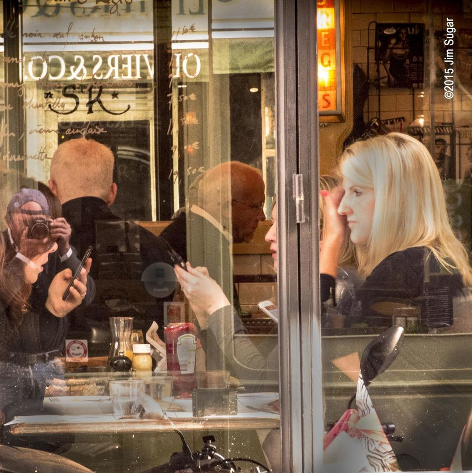 After eating breakfast at the Restaurant Saint Regis on the Ile Saint-Louis next to the Seine in Paris, I wandered outside and shot back into the interior of the restaurant. Multiple mirrors and sheets of glass created bizarre layers of images including a reflection of the photographer. A snapshot of people going on with their daily lives. On your next trip to Paris, check out this restaurant. Noisy, great food, fun. Very French. Shot with the Panasonic Lumix – – excellent street camera. @thephotosociety @natgeocreative #paris #seine #unsquares #panasoniclumix #ilestelouis