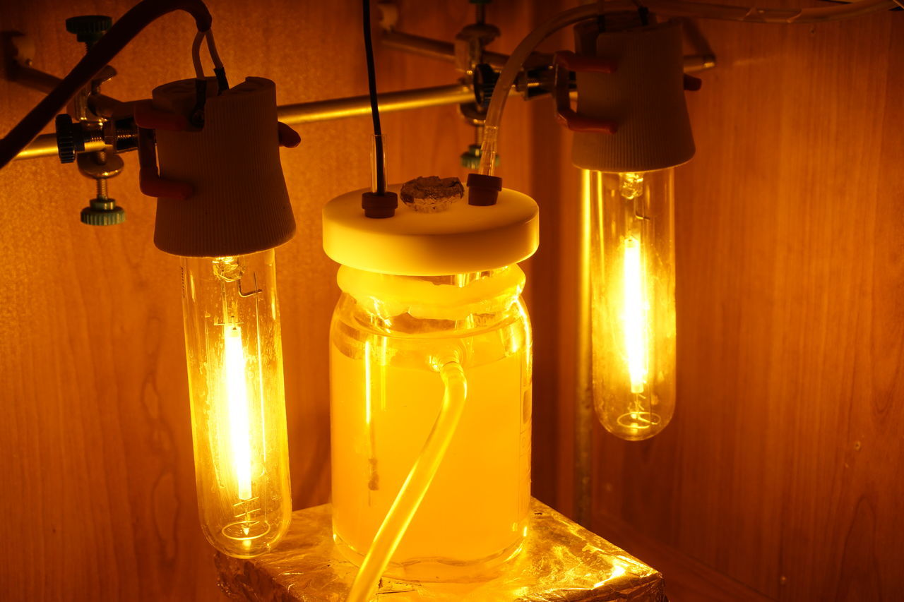 Photoreactor Reaction under high concentration light source. Illuminated Science Chemistry Sony A6000 Orange Color Glowing Light Source Engineering EngineeringStudent University Golden Shimmer Eyeem Collection Eyeem Market