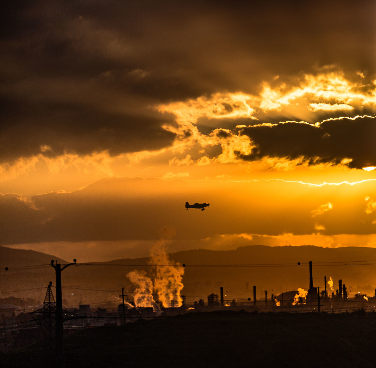 Air Tractor AT-802 Air Vehicle Aircraft Airplane AT-802 Beauty In Nature Cloud - Sky Dawn Facilities Flying Light Light And Shadow Mode Of Transport Mountain Orange Orange Color Outdoors Silhouette Sky Smoke Sunlight Transportation