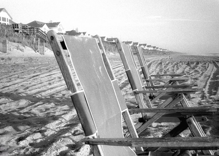 Sea Beach Water Tranquil Scene In A Row Travel Destinations Outdoors Vacations Tourism Shore 35mm Film Coastline Beach Chairs Sand Outer Banks, NC Ocean Blackandwhite Bnw Monochrome Black And White
