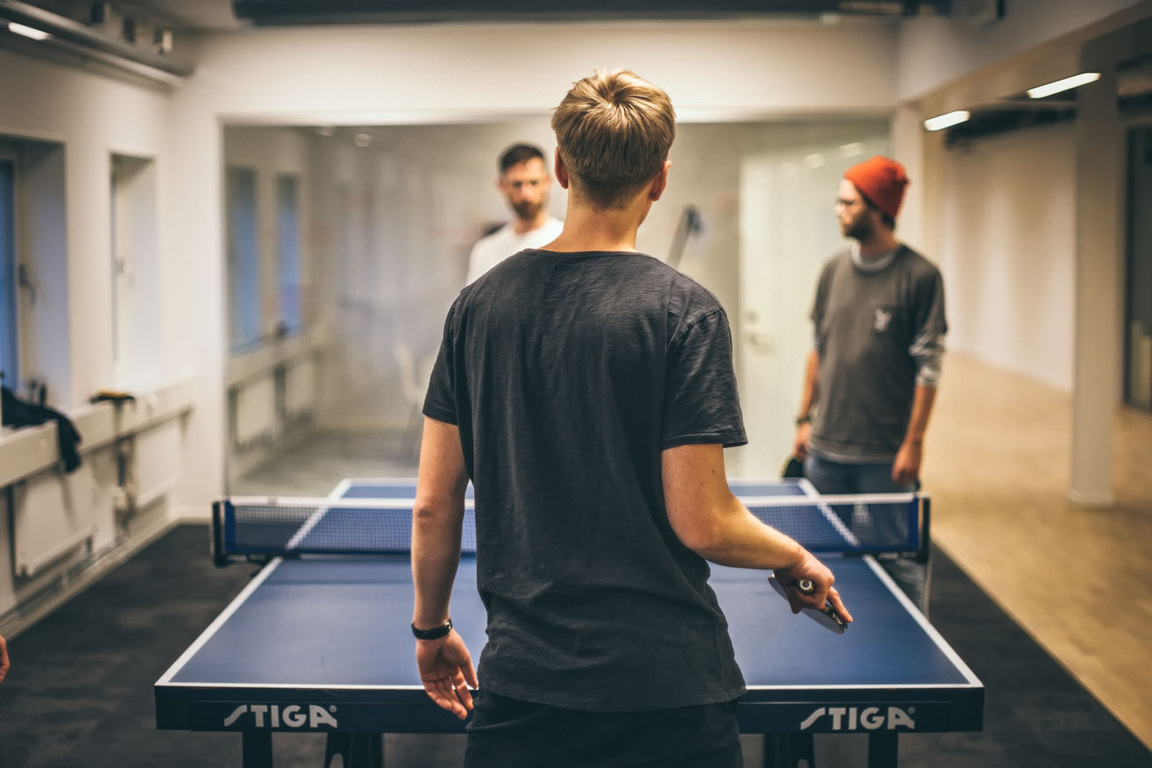 Playing table tennis in our Office at Apegroup in Stockholm Sweden. Agency Day Indoors  Leisure Activity Men Occupation Office Only Men People Perspective Real People Small Business Sport Sports Standing Startup Table Tennis Vintage Workshop Young Adult