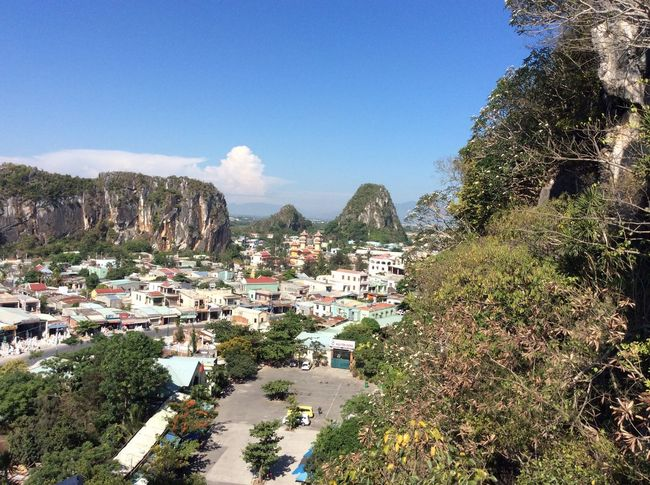 DaNang, Vietnam from marble mountain Tree Architecture Building Exterior Built Structure High Angle View Town Blue Sunlight Nature Sea Clear Sky Mountain Outdoors Day Village Residential Building Beauty In Nature Sky Palm Tree