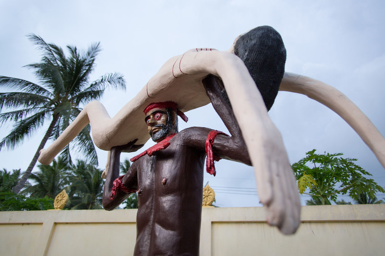 Wat Samai Kongka - buddhist temple on Phangan island in the Gulf of Thailand, decorated with unusual sculptures by one of the monks. Bardo Buddhism Full Moon Party Hell Yea Horror Island Ko Phangan Outdoors Palm Punishment Purgatory Sacrifice Sculpture Sins Sky South East Asia Temple Thailand Tourism Warning