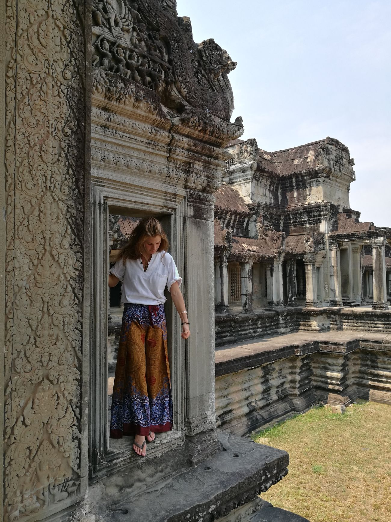 Oh my god, I'm so lucky! Angkor Wat, Cambodia Architecture Place Of Worship Travel Destinations One Woman Only My Girl Hot Weather Beautiful Woman No Filter, No Edit, Just Photography Dykkingithailand Lifeisbetterunderwater Huawei P9 Leica Instagood Wanderlust No Filter Ancient Civilization History Tourism Architecture Most Beautiful Girl In The World