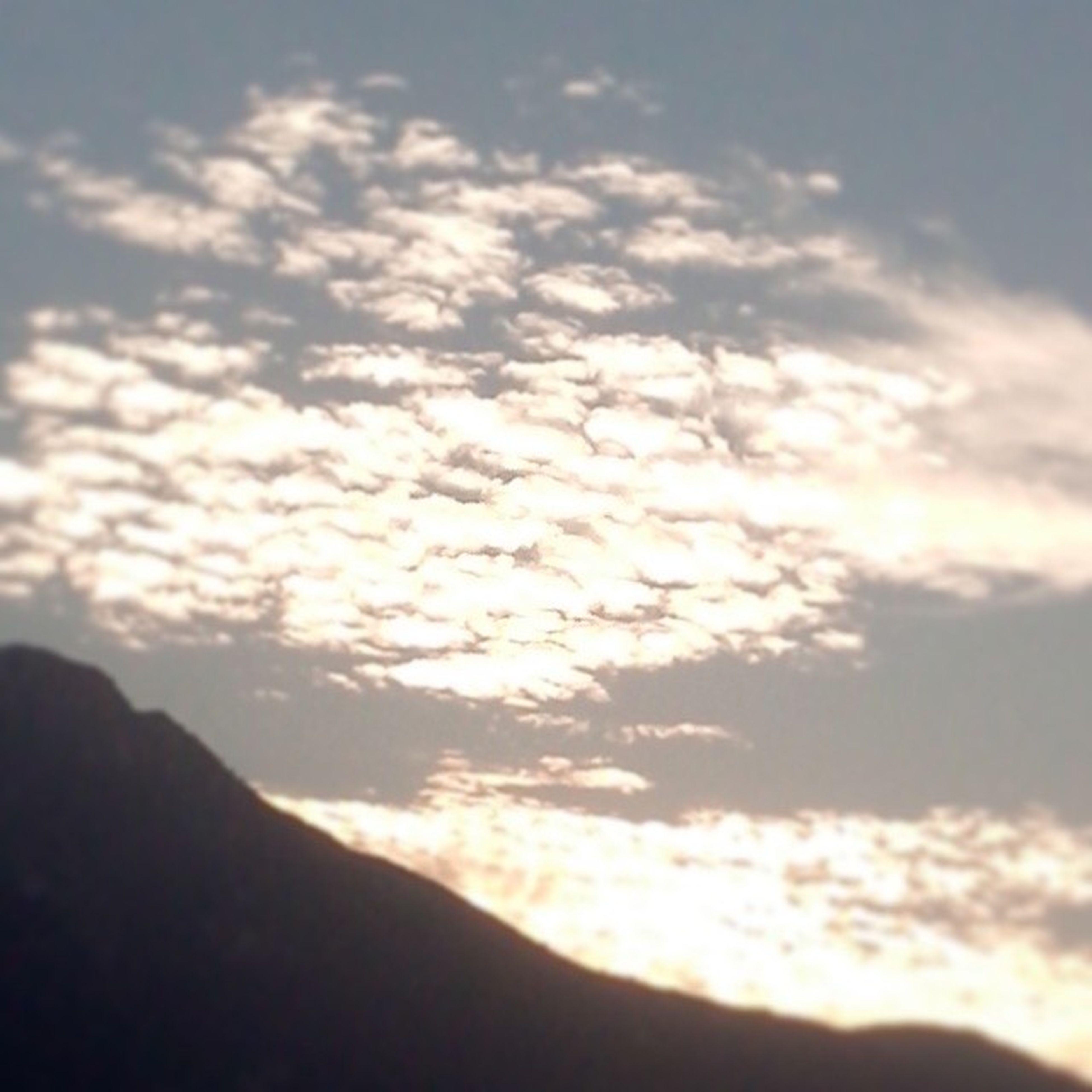 sky, tranquil scene, tranquility, scenics, beauty in nature, cloud - sky, sunset, silhouette, nature, mountain, cloud, cloudy, idyllic, outdoors, landscape, non-urban scene, no people, majestic, sunlight, non urban scene