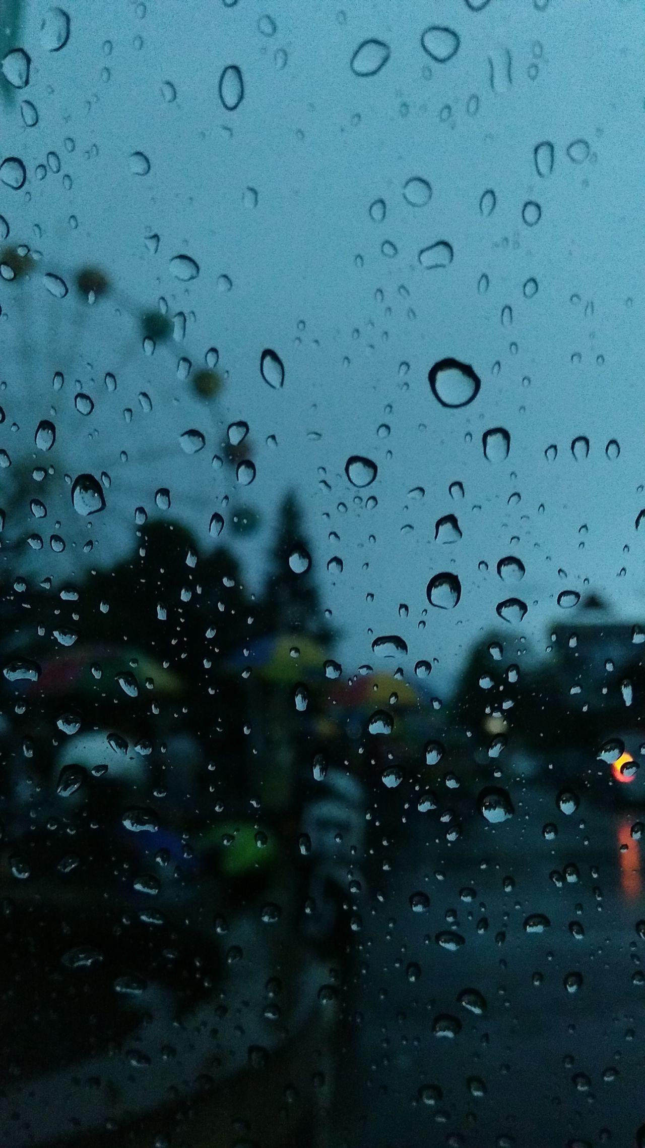 Waiting inside Rain Raindrops Water Glass Window View Ferris Wheel Motorcycle Light And Shadow Dark