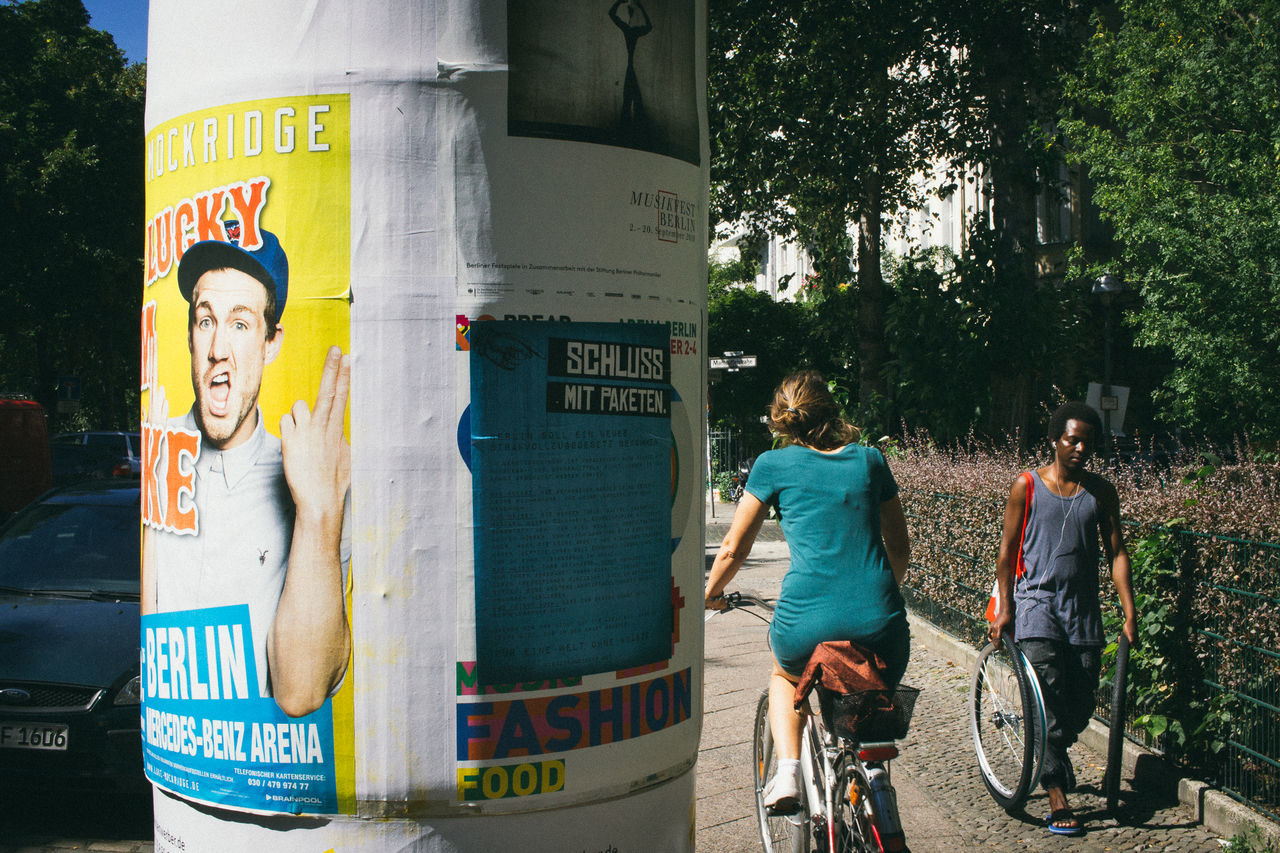 24mm Berlin Biycle Casual Clothing City Life People Signboard Street Photography Streetphotography Urban VSCO