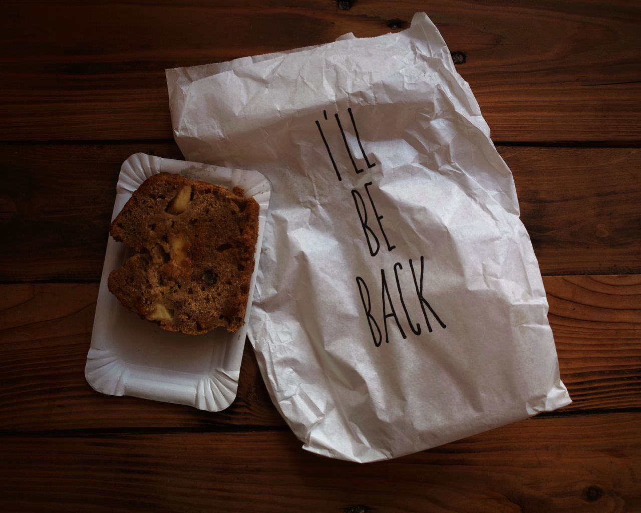 The I'll be back bag. High Angle View Paper Indoors  No People Food Food And Drink Tissue Tissue Paper Close-up Freshness Day Ready-to-eat Cake Bag Dessert Cake Time Lettering Letters Writing Font Handwriting  Coffee Time