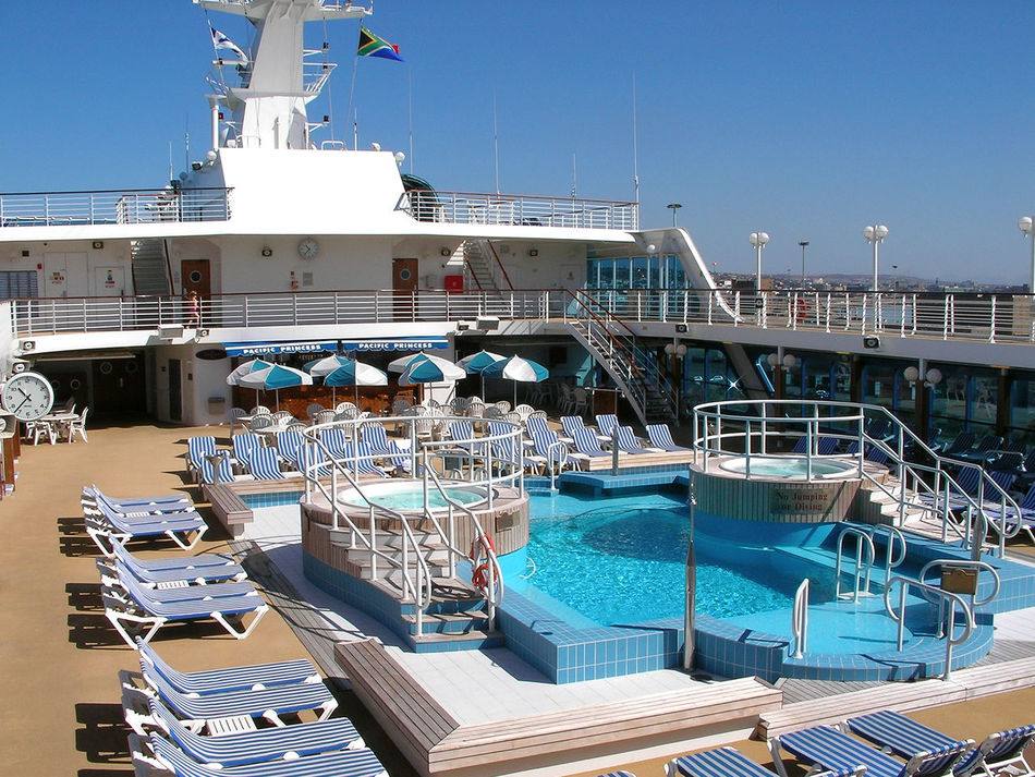 Lido Deck Architecture Blue Building Exterior Built Structure Clear Sky Day Empty Sunbeds Empty Swimming Pool Mode Of Transport Moored Nature Nautical Vessel No People Outdoors Sea Sky Sunlight Transportation Vacations Water Yacht Breathing Space