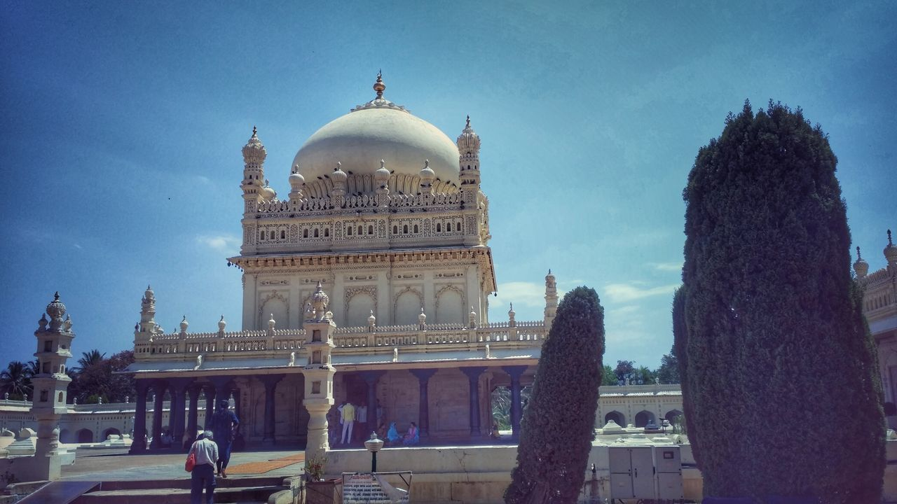 architecture, built structure, building exterior, sky, dome, religion, travel destinations, history, low angle view, day, spirituality, tourism, outdoors, place of worship, travel, real people, facade, large group of people, tree, people