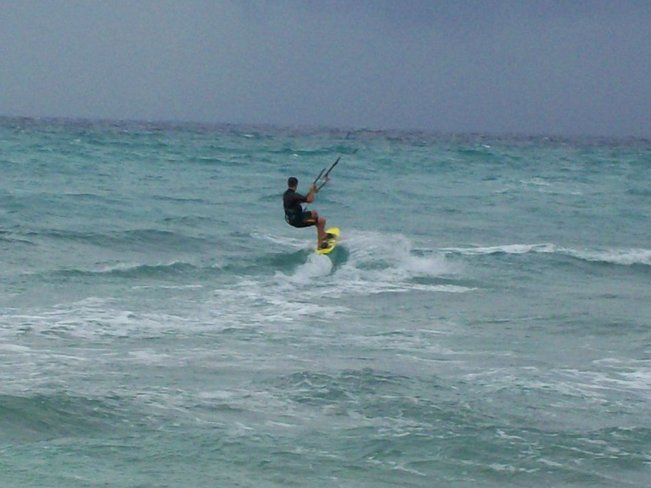 Adult Adventure Balance Day Extreme Sports Horizon Over Water Kitesurfing Leisure Activity Lifestyles Men Motion One Man Only One Person Outdoors Sea Skill  Sky Sport Vacations Water Waterfront Wave Weekend Activities