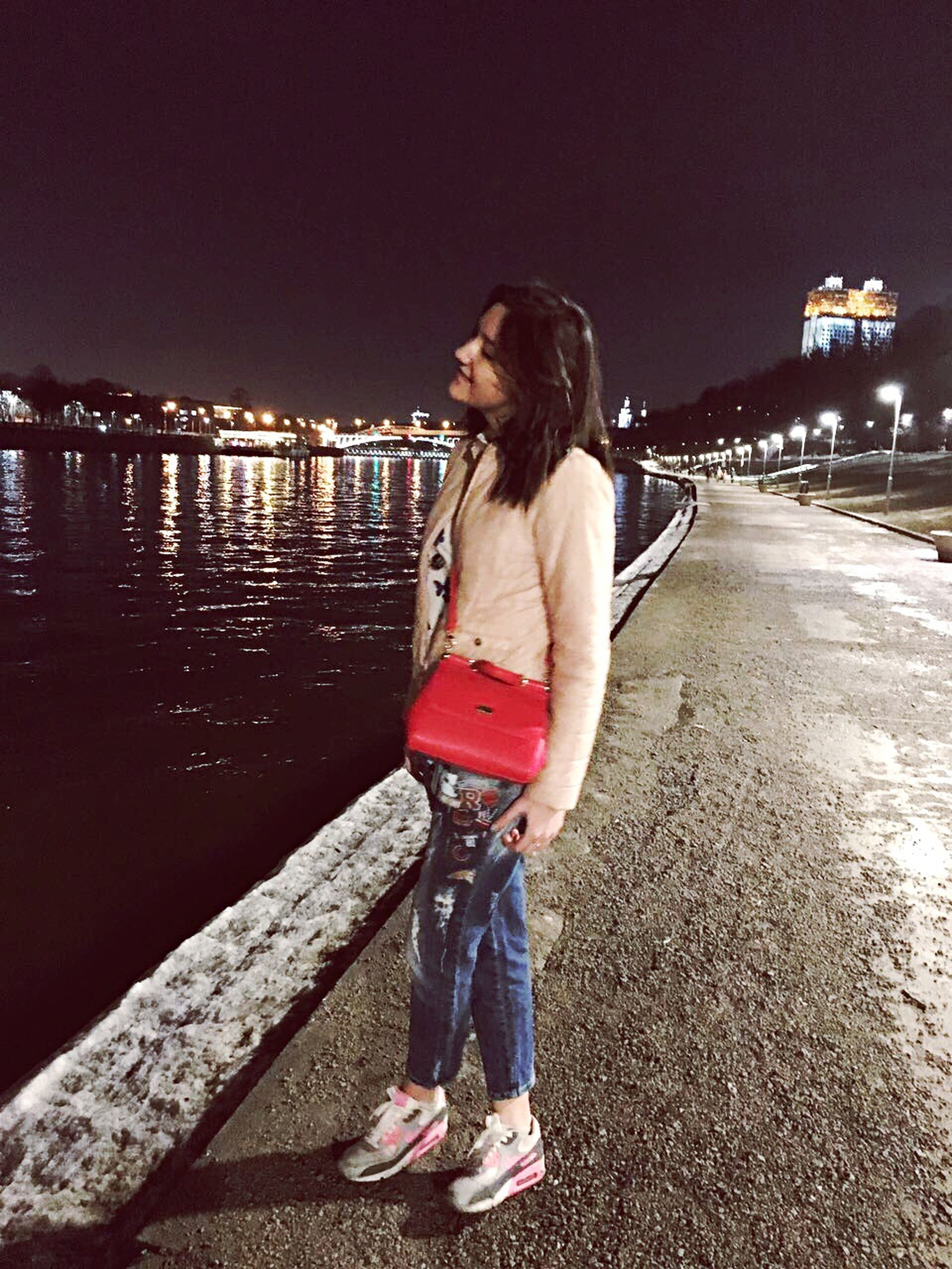 one person, only women, adults only, one woman only, night, full length, young adult, leisure activity, red, outdoors, standing, people, adult, young women, women, one young woman only, beautiful woman, sky, city, bridge - man made structure, nature