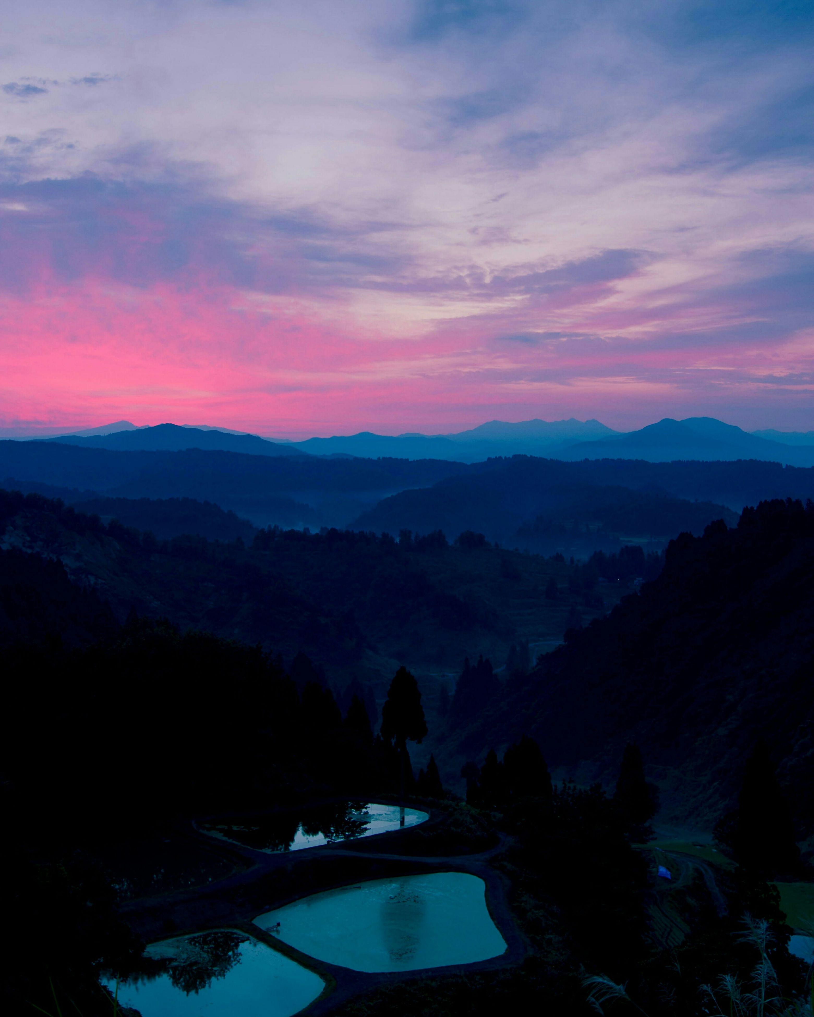 mountain, sunset, mountain range, scenics, sky, tranquil scene, beauty in nature, tranquility, silhouette, cloud - sky, landscape, nature, orange color, idyllic, cloud, dusk, lake, transportation, water, non-urban scene