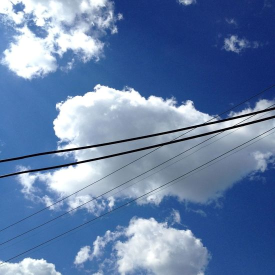 Blue Power Lines Clouds And Sky