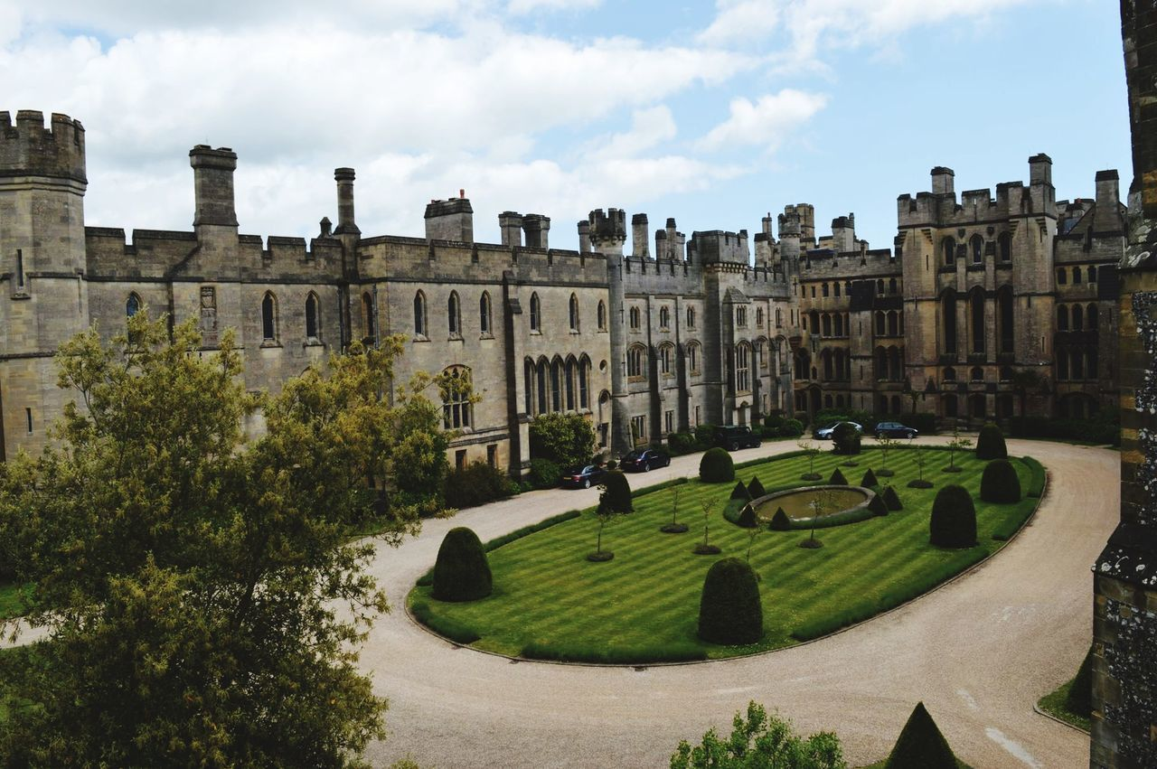 architecture, built structure, history, the past, building exterior, sky, castle, day, cloud - sky, ancient, travel destinations, outdoors, tree, no people, panoramic, grass, golf course, ancient civilization