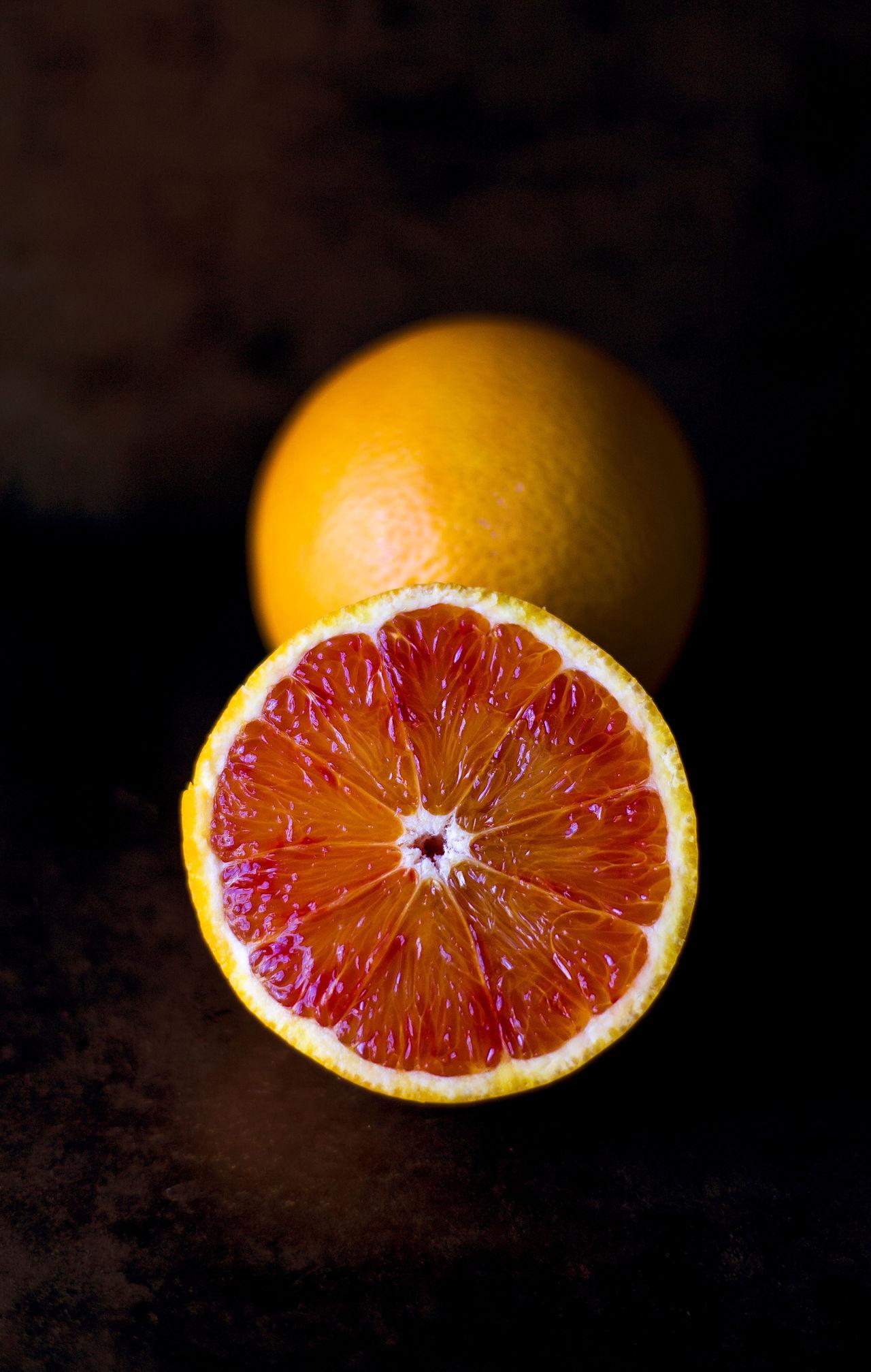 Black Background Blood Orange Citrus Fruit Close-up Cross Section Food Food And Drink Freshness Fruit Grapefruit Halved Healthy Eating Healthy Lifestyle Indoors  Juicy No People Orange - Fruit SLICE Sour Taste Squeezing Studio Shot Vitamin Yellow