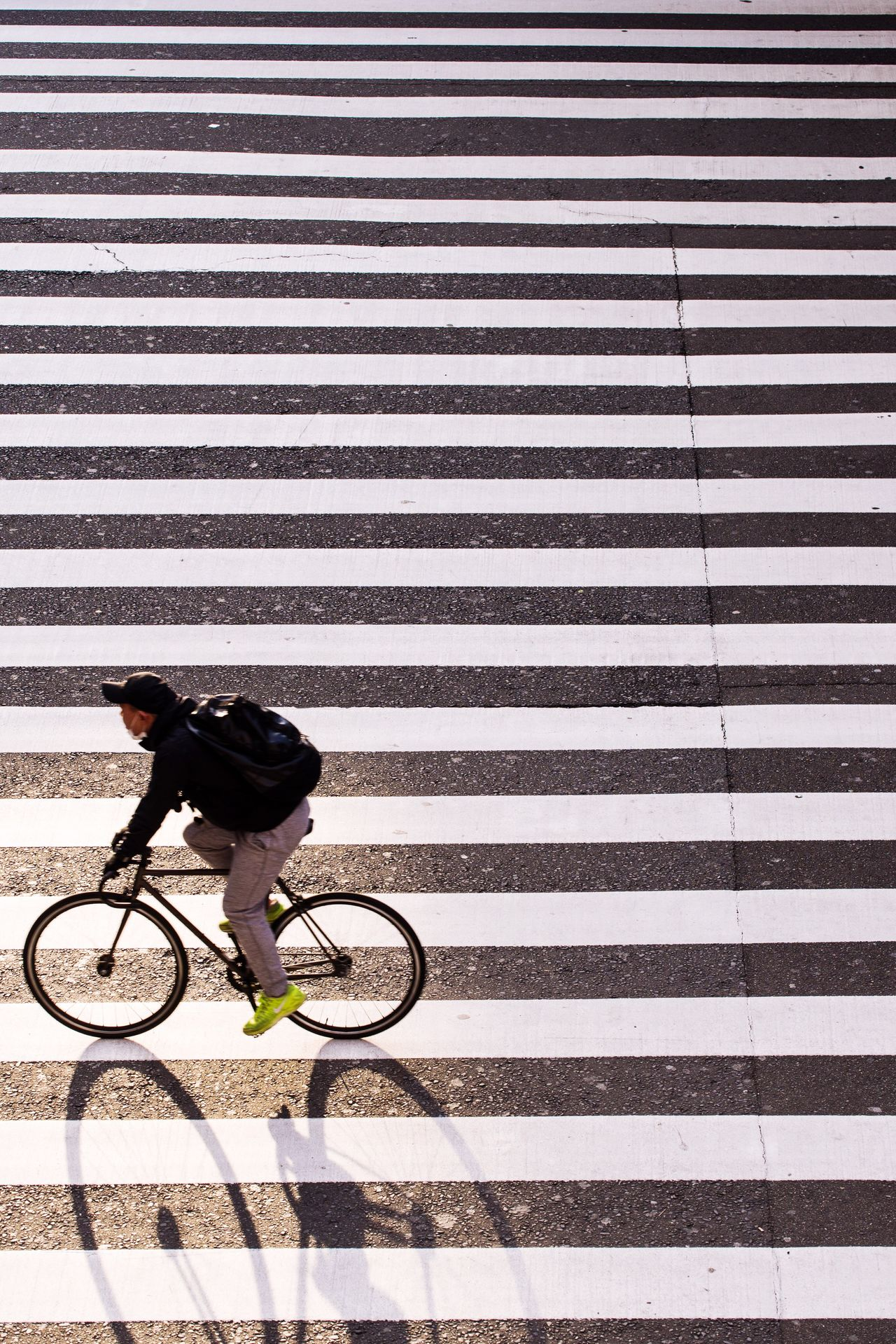 bycile in the lines Bicycle Street Cycling City One Person City Life Urban Road Streetphotography OSAKA Japan City Street Minimalism Minimalist Minimal Only Men Light And Shadow Strideby