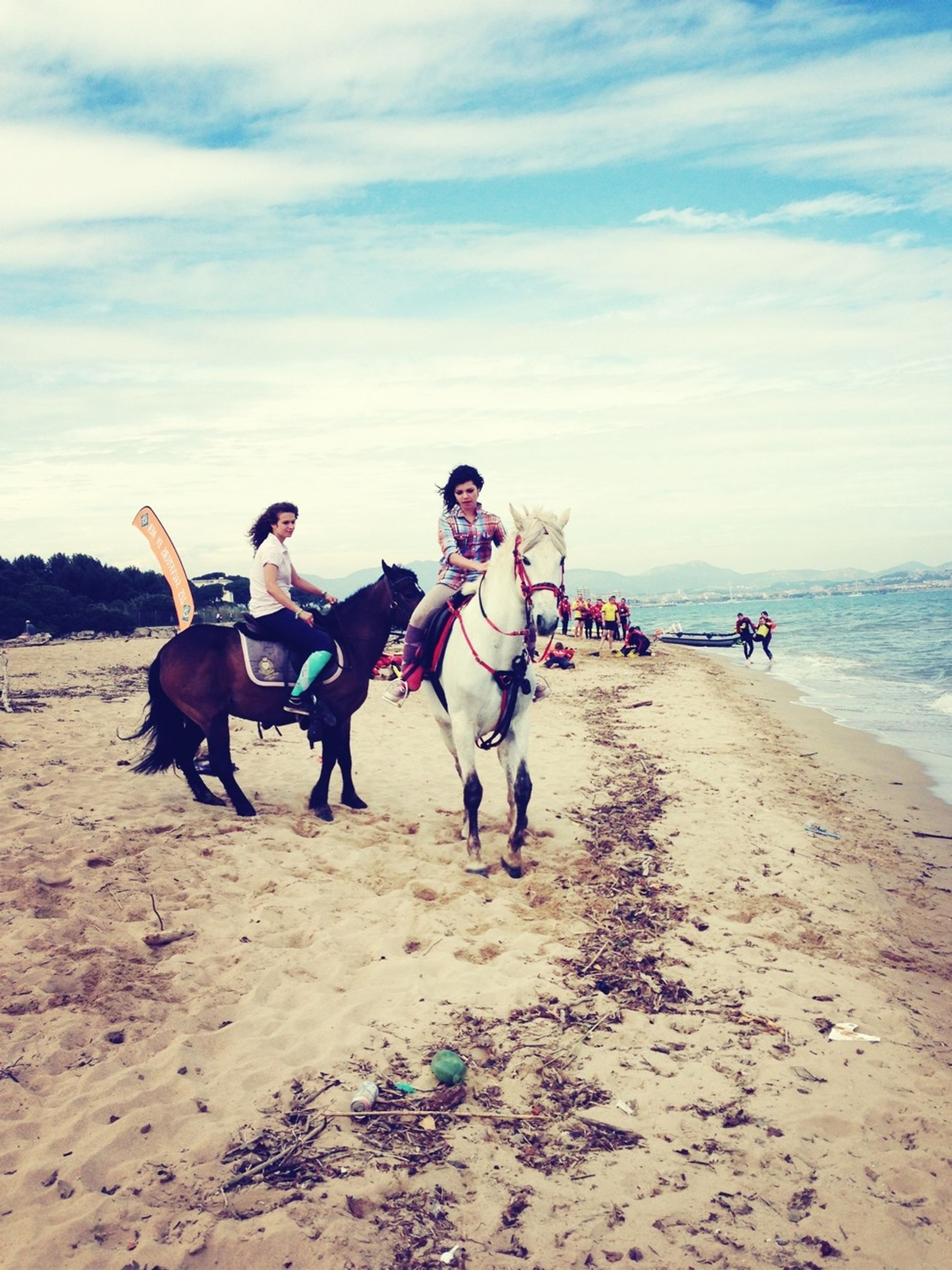 beach, sand, lifestyles, leisure activity, full length, sky, domestic animals, vacations, enjoyment, togetherness, men, sea, animal themes, shore, mammal, casual clothing, riding, horse, water
