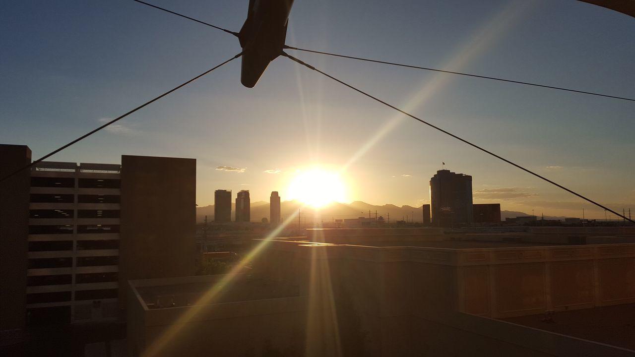 sunset, sun, sunlight, sunbeam, architecture, silhouette, lens flare, city, cable, built structure, no people, building exterior, sky, cityscape, outdoors, nature