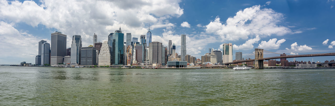 Manhattan New York City USA Architecture Bridge - Man Made Structure Building Exterior Built Structure City Cityscape Cloud - Sky Connection Day Modern Nature No People Outdoors River Sky Skyscraper Suspension Bridge Travel Destinations Urban Skyline Water Waterfront