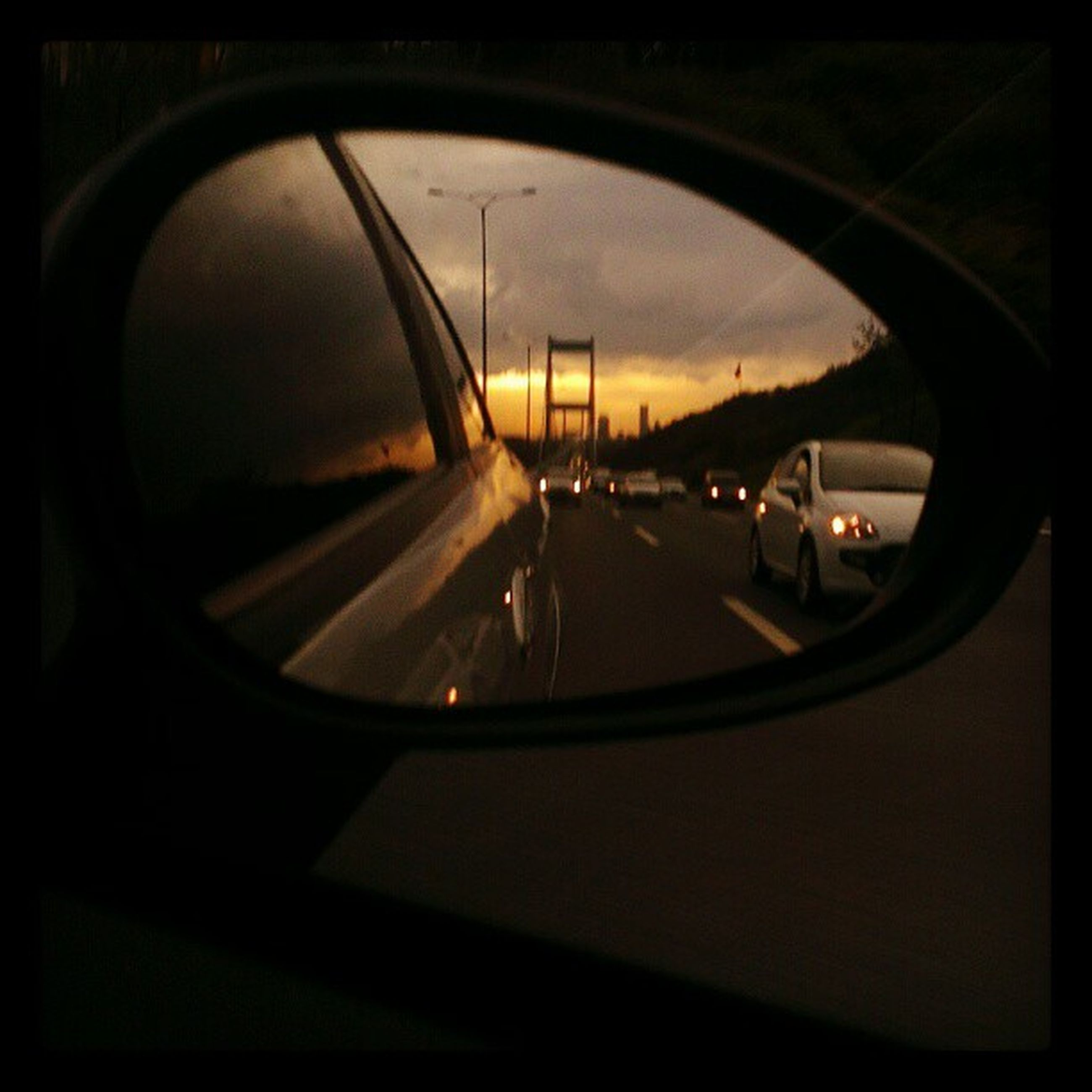 transfer print, transportation, auto post production filter, indoors, mode of transport, reflection, car, sky, window, no people, land vehicle, circle, glass - material, vehicle interior, dark, close-up, sunset, transparent, street, travel