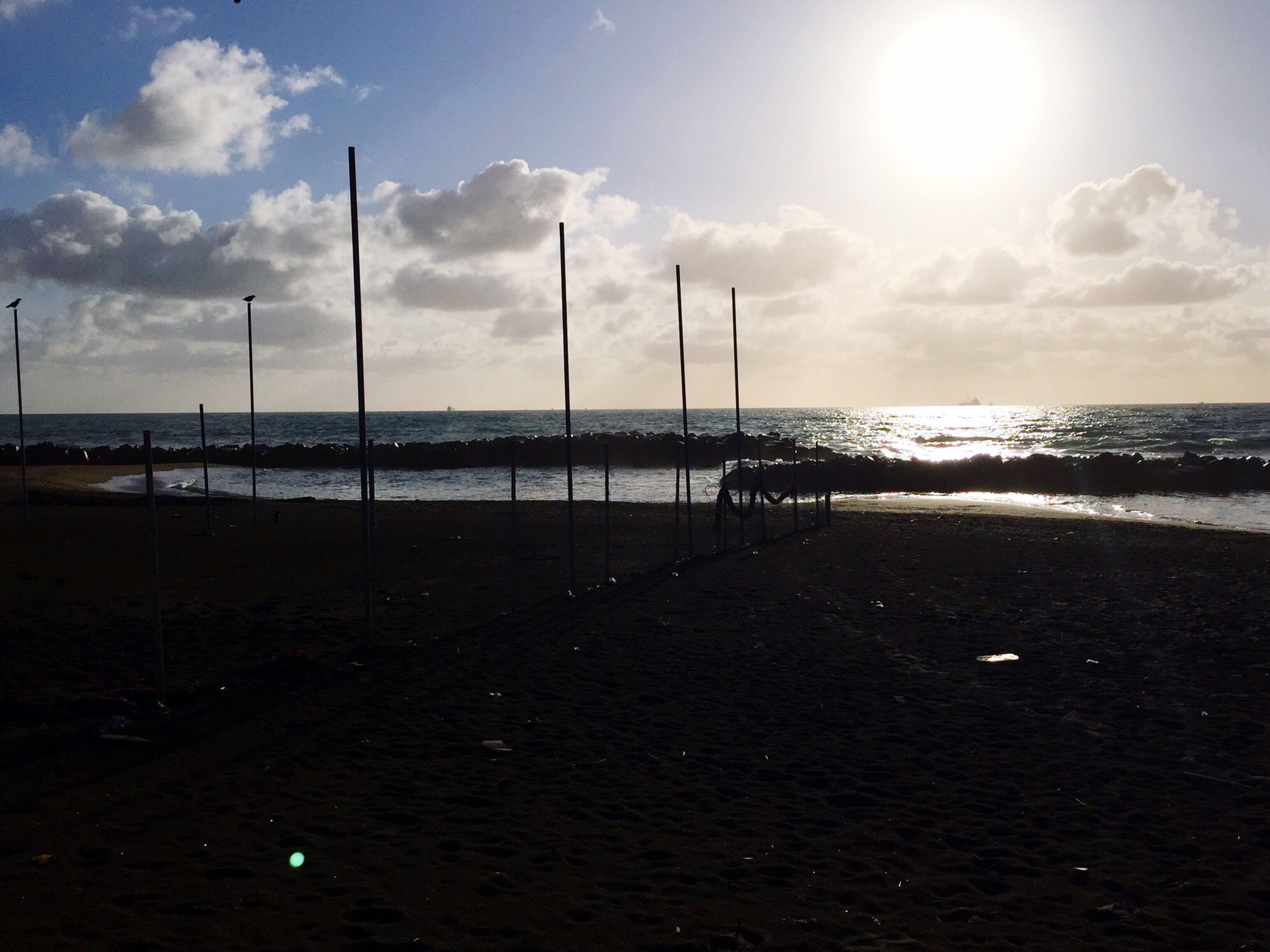 sea, horizon over water, water, beach, sky, shore, tranquil scene, tranquility, scenics, beauty in nature, nature, sand, sunlight, cloud - sky, idyllic, sun, pier, cloud, incidental people, sunbeam