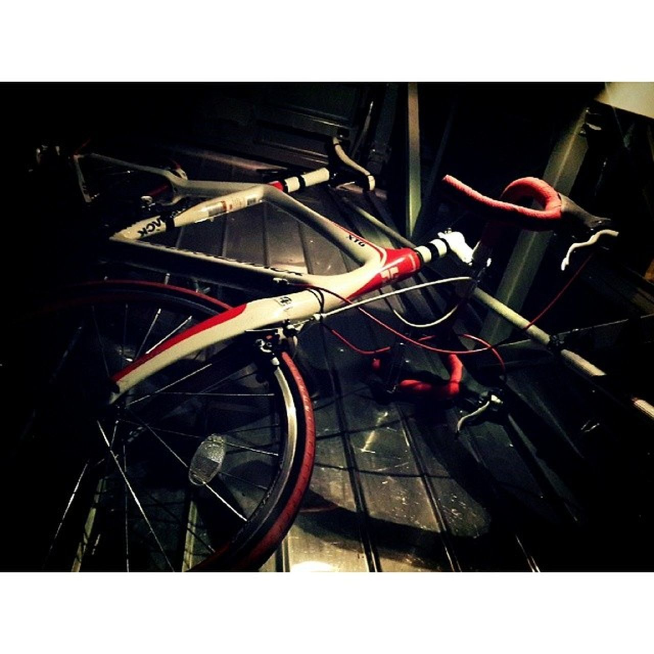 transfer print, transportation, mode of transport, land vehicle, auto post production filter, car, stationary, bicycle, parked, travel, wheel, high angle view, no people, parking, outdoors, part of, metal, day, street