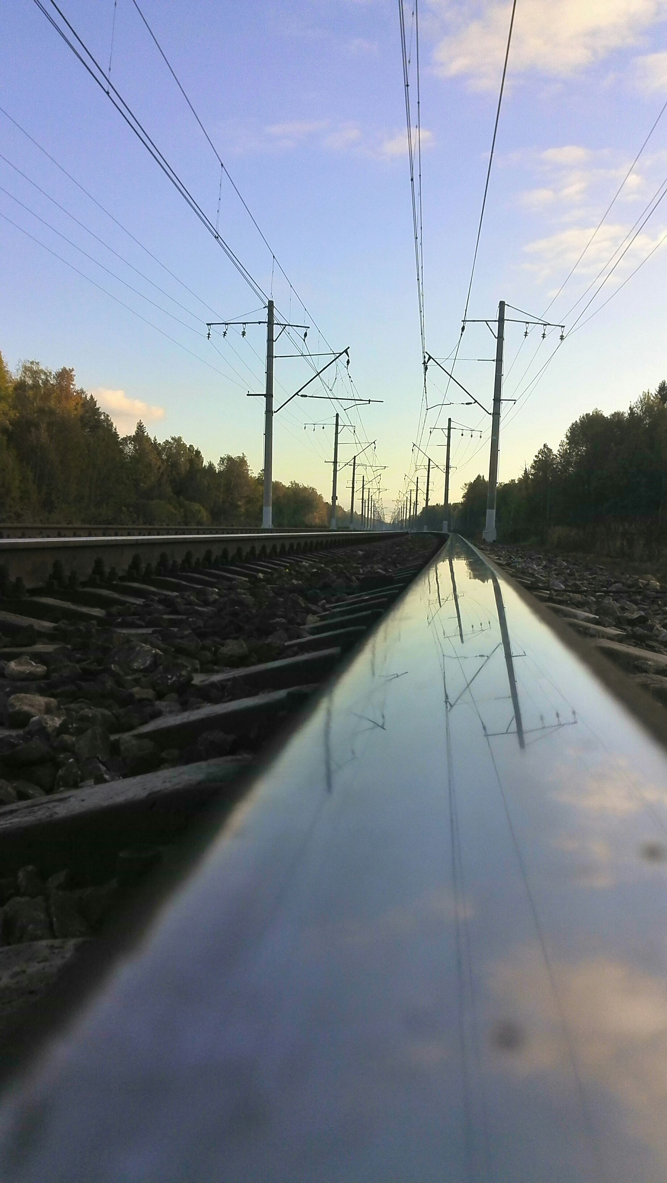 power line, railroad track, electricity pylon, rail transportation, power supply, connection, electricity, transportation, cable, sky, diminishing perspective, the way forward, fuel and power generation, power cable, tree, vanishing point, railway track, public transportation, no people, nature