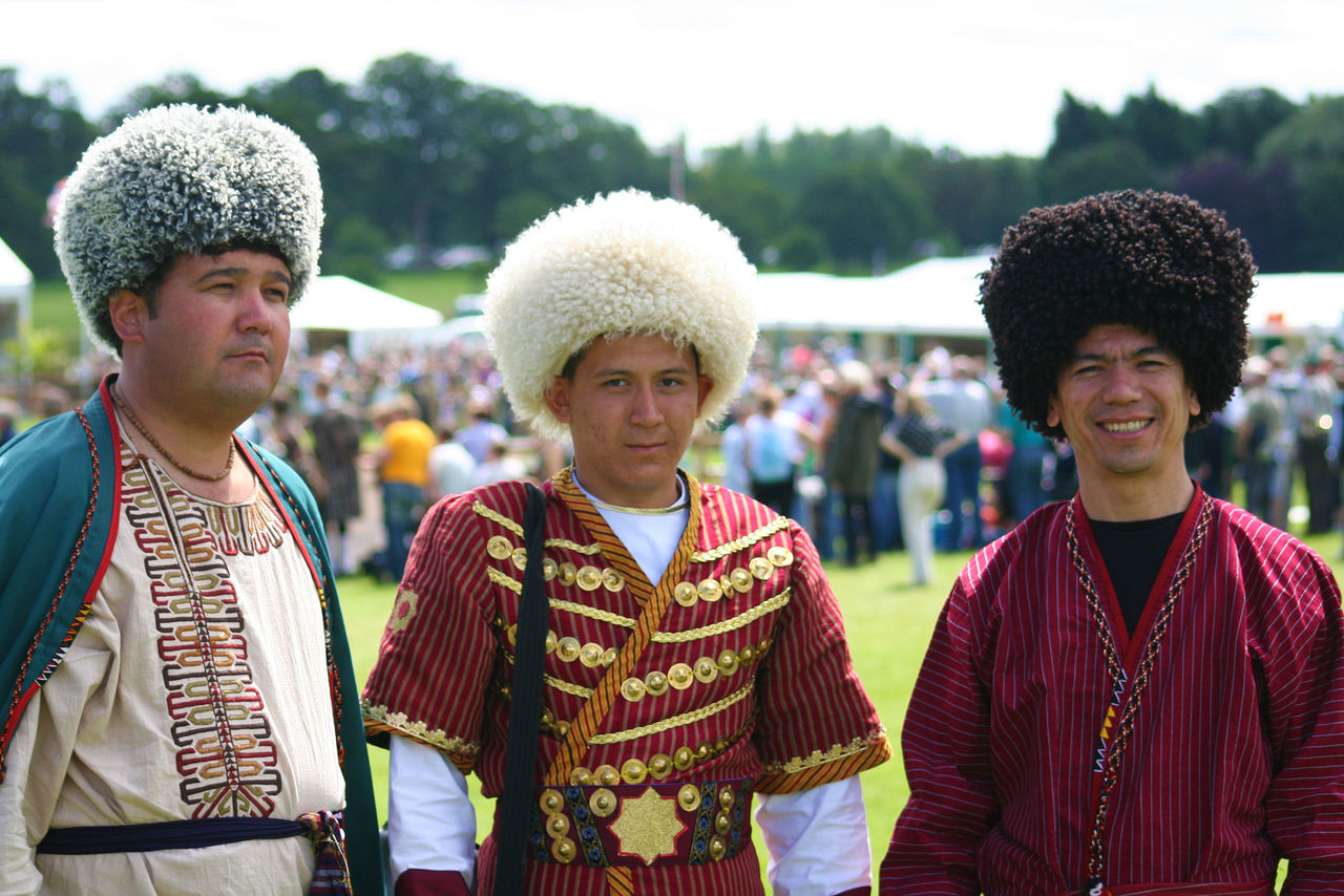incidental people, looking at camera, real people, smiling, togetherness, portrait, focus on foreground, outdoors, day, traditional clothing, front view, celebration, lifestyles, celebration event, young adult, happiness, standing, young men, leisure activity, couple - relationship, men, young women, performance, women, cheerful, clown, bridegroom, people